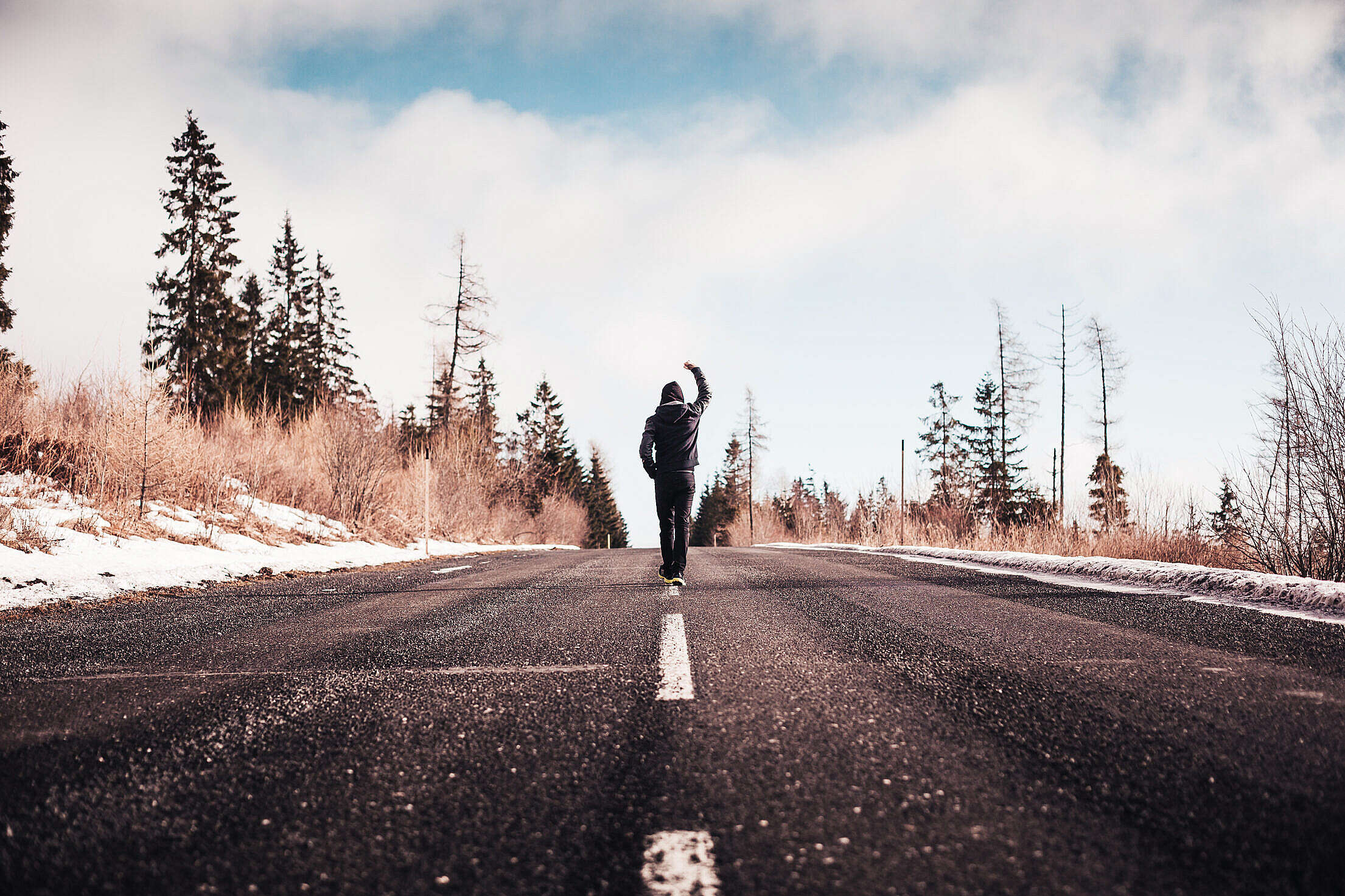 Man in a Winner Pose Walking on the Road Free Stock Photo