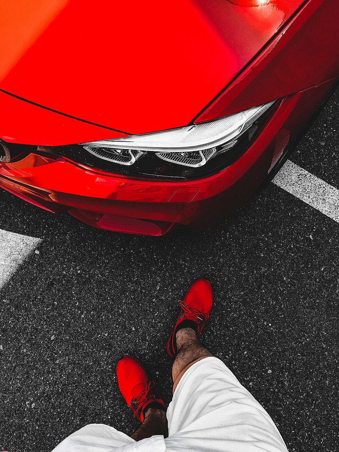Download Man in Red Shoes Standing in Front of Ferrari-Red BMW FREE Stock Photo