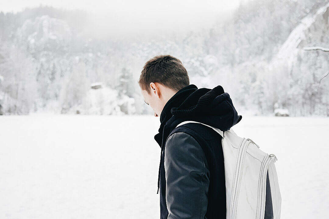 Download Man in the Middle of Snowy Valley FREE Stock Photo