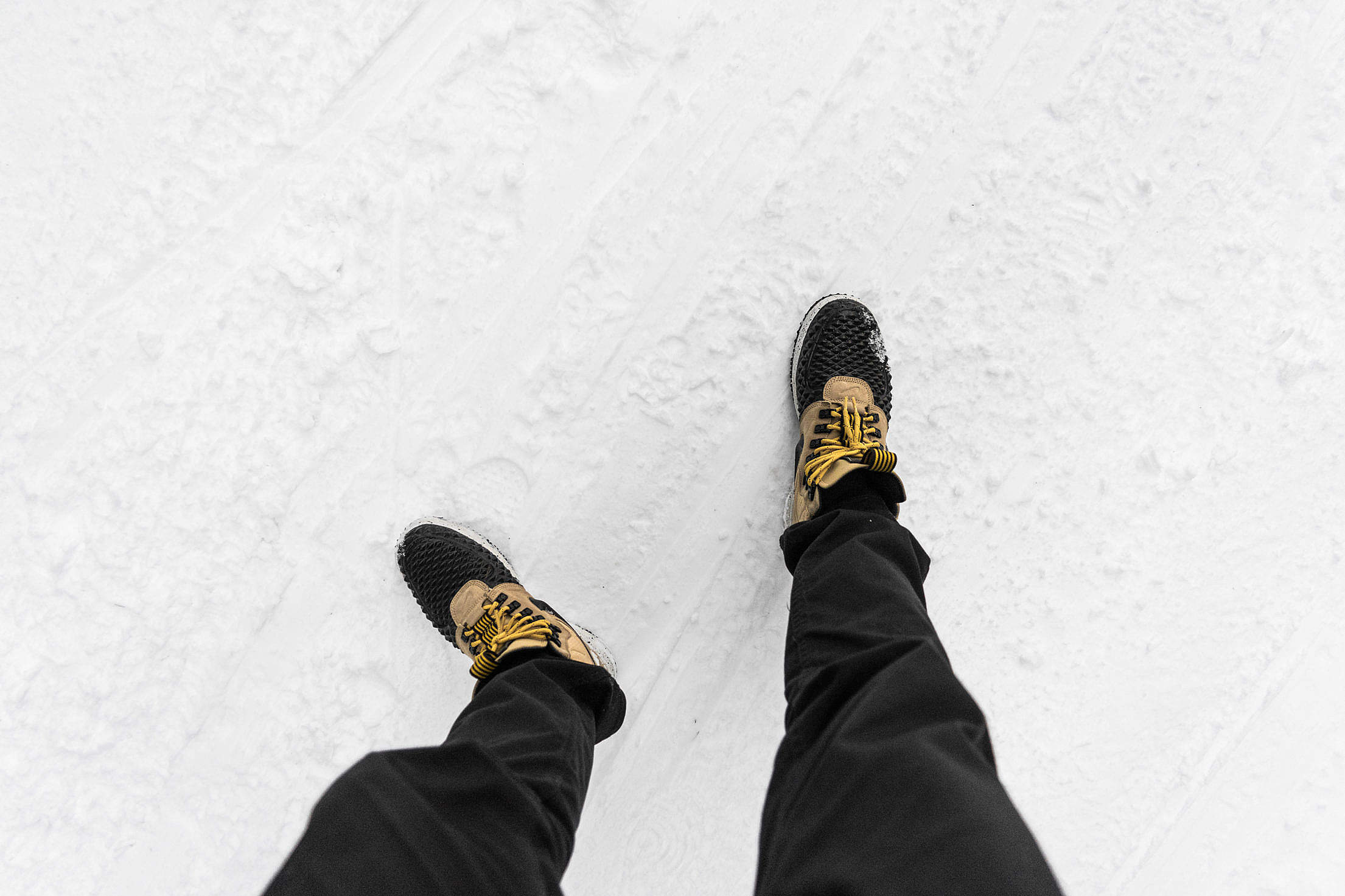 Man in Winter Shoes on Snow Covered Road FPV Free Stock Photo
