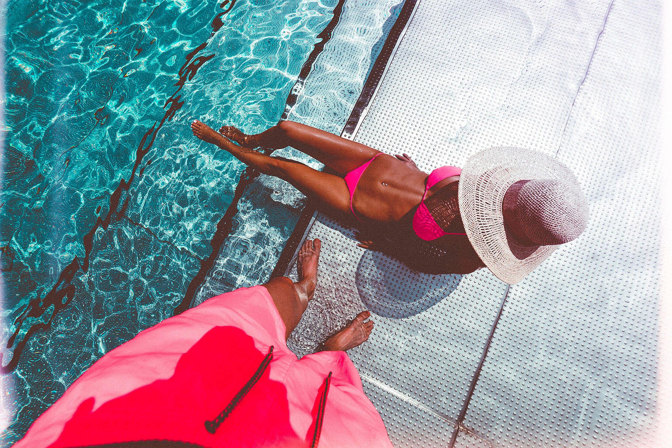 Man Looking at His Sexy Fitness Wife in Bikini Free Stock Photo