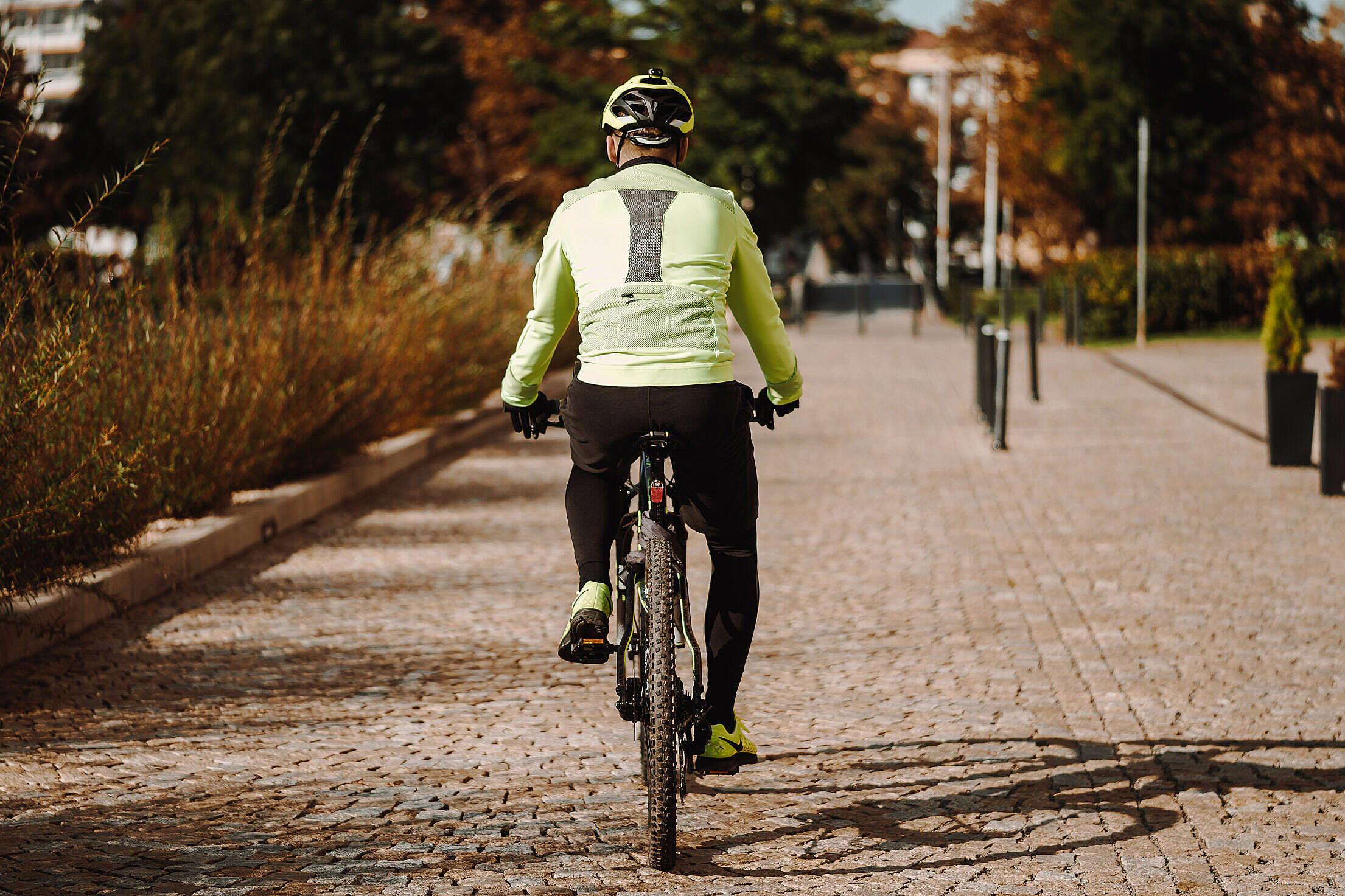 Man on a Bike in Fall Free Stock Photo