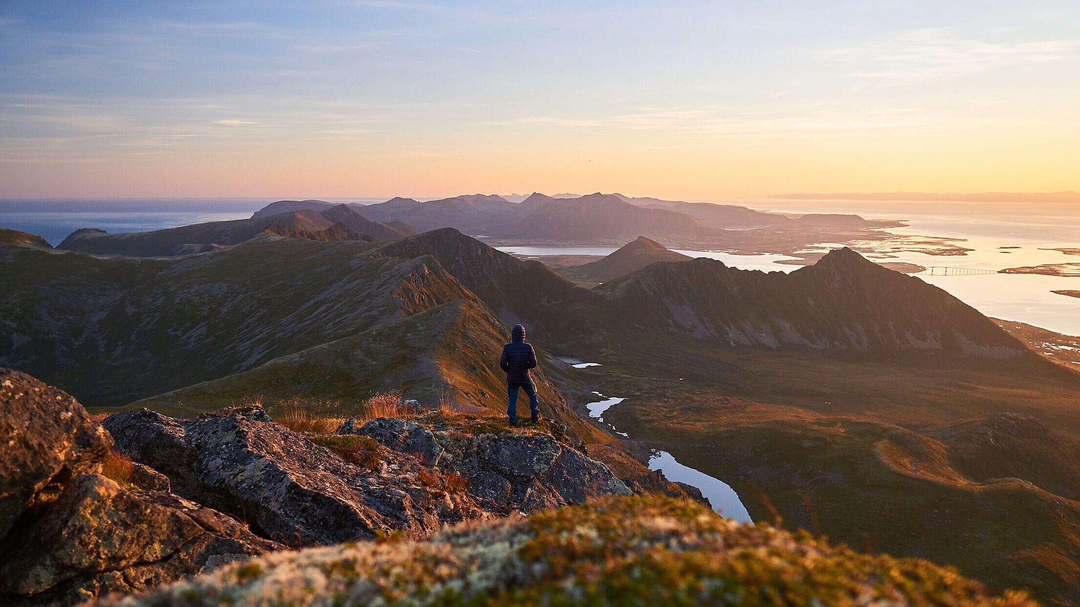Man on Hiking Adventure During Beautiful Sunrise Free Stock Photo
