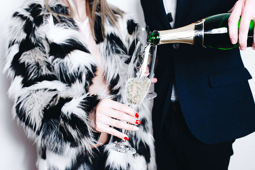 Download Man Pouring Glass of Champagne FREE Stock Photo
