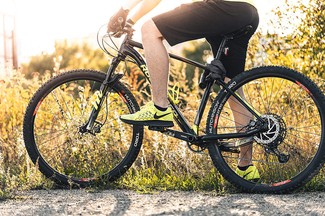 Download Man Sitting on a Mountain Bike FREE Stock Photo