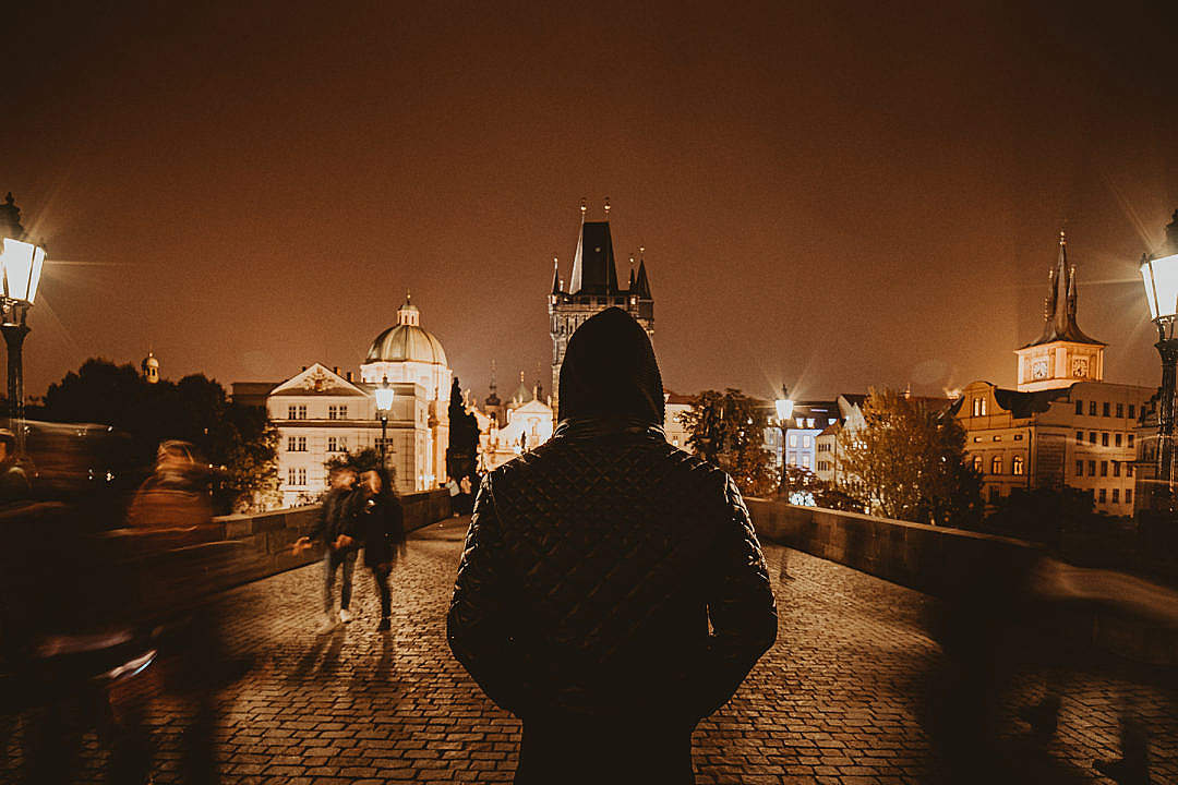 Download Man Standing on Charles Bridge in Prague FREE Stock Photo