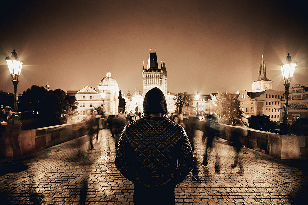 Download Man Standing on Prague's Charles Bridge in Sepia Tone FREE Stock Photo