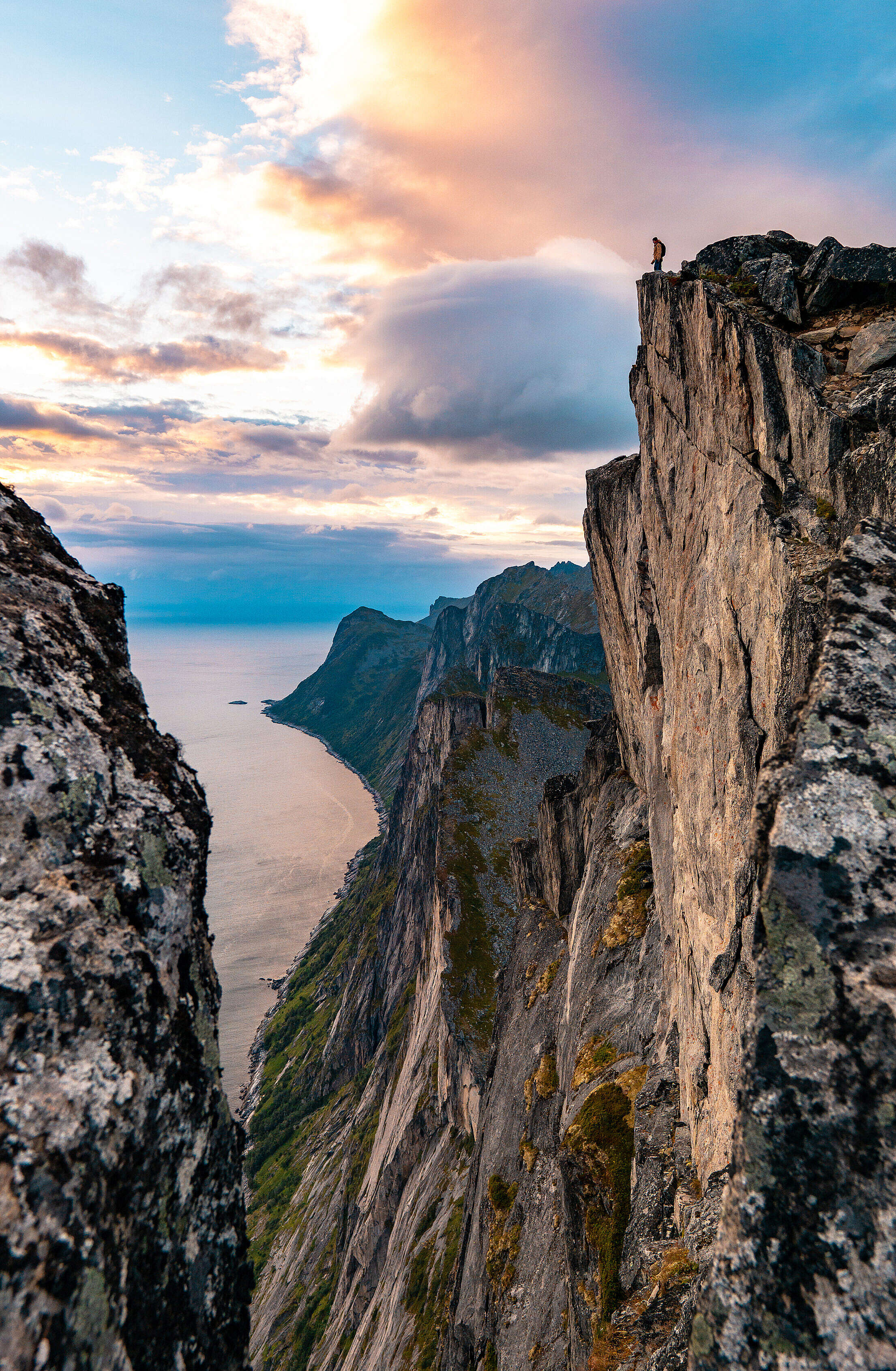 Man Standing on the Edge of the Cliff on Senja Island Free Stock Photo