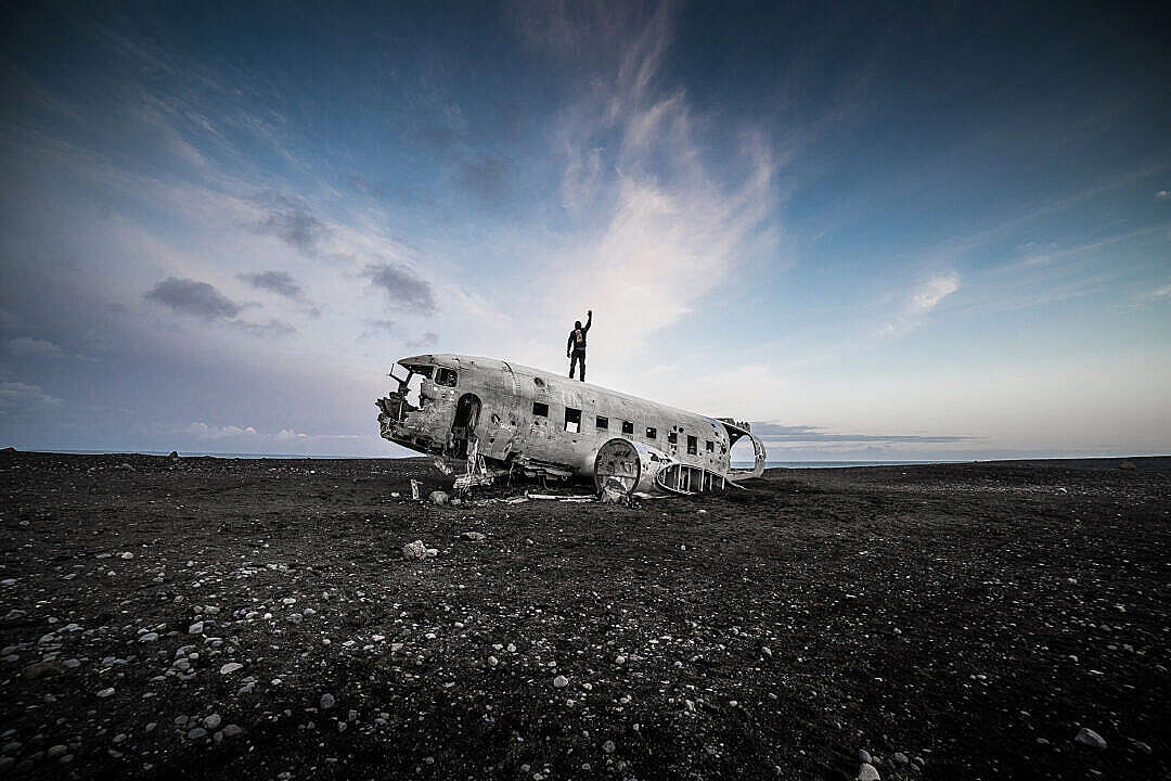 Download Man Standing on Top of the Iceland Famous Plane Wreckage FREE Stock Photo