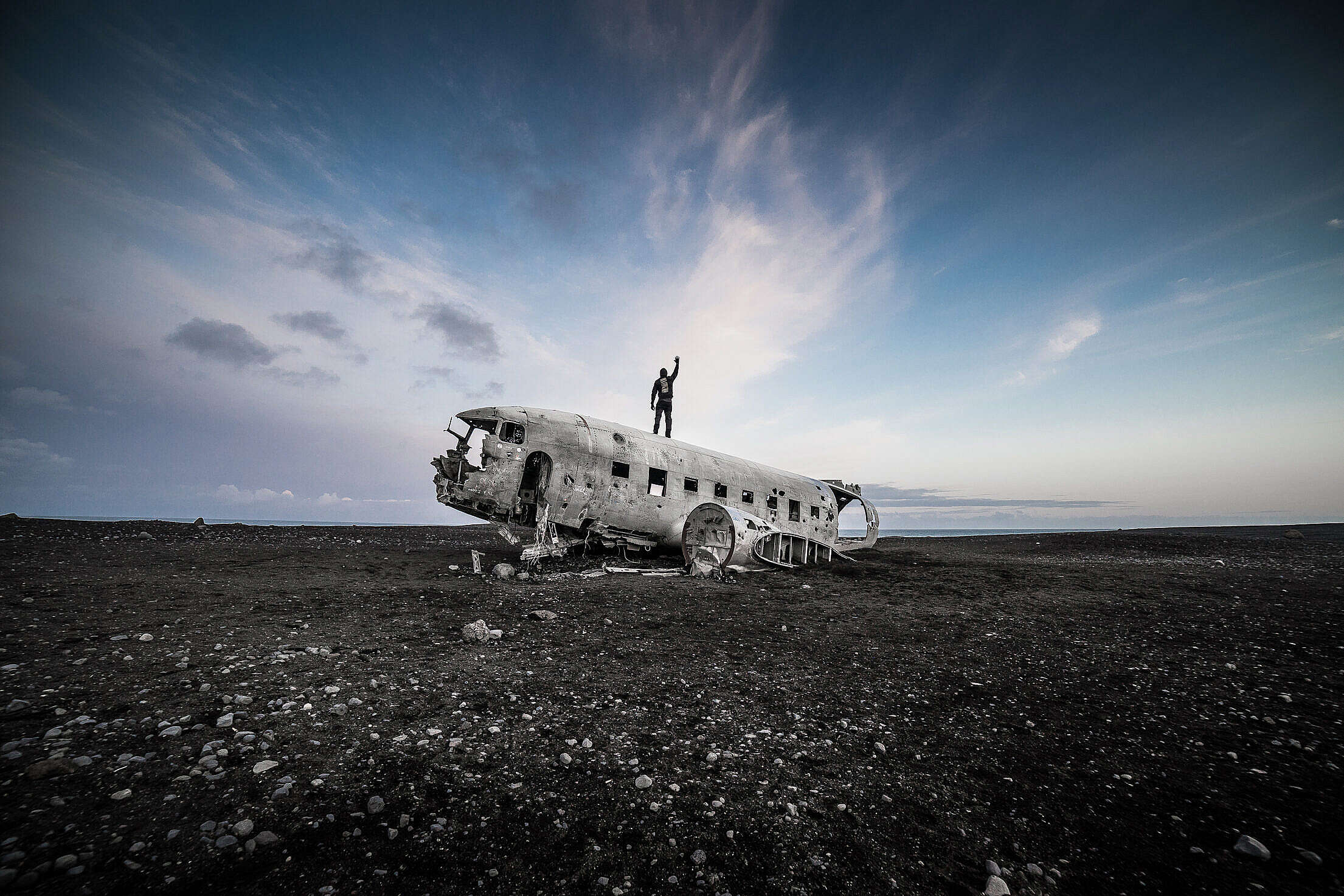 Man Standing on Top of the Iceland Famous Plane Wreckage Free Stock Photo