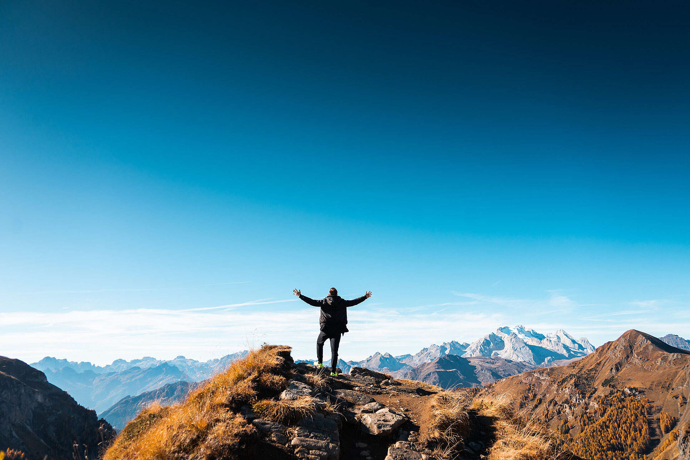 Man Standing on Top of The Mountain Free Stock Photo