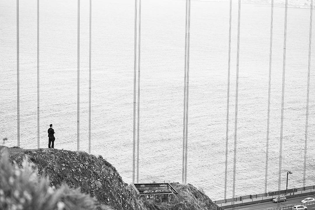 Download Man Stands at The Edge of The Cliff Near The Golden Gate Bridge FREE Stock Photo