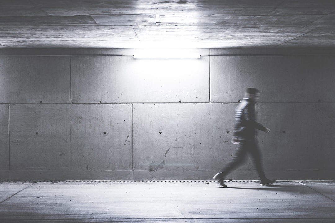 Download Man Walking Through Concrete Underpass FREE Stock Photo