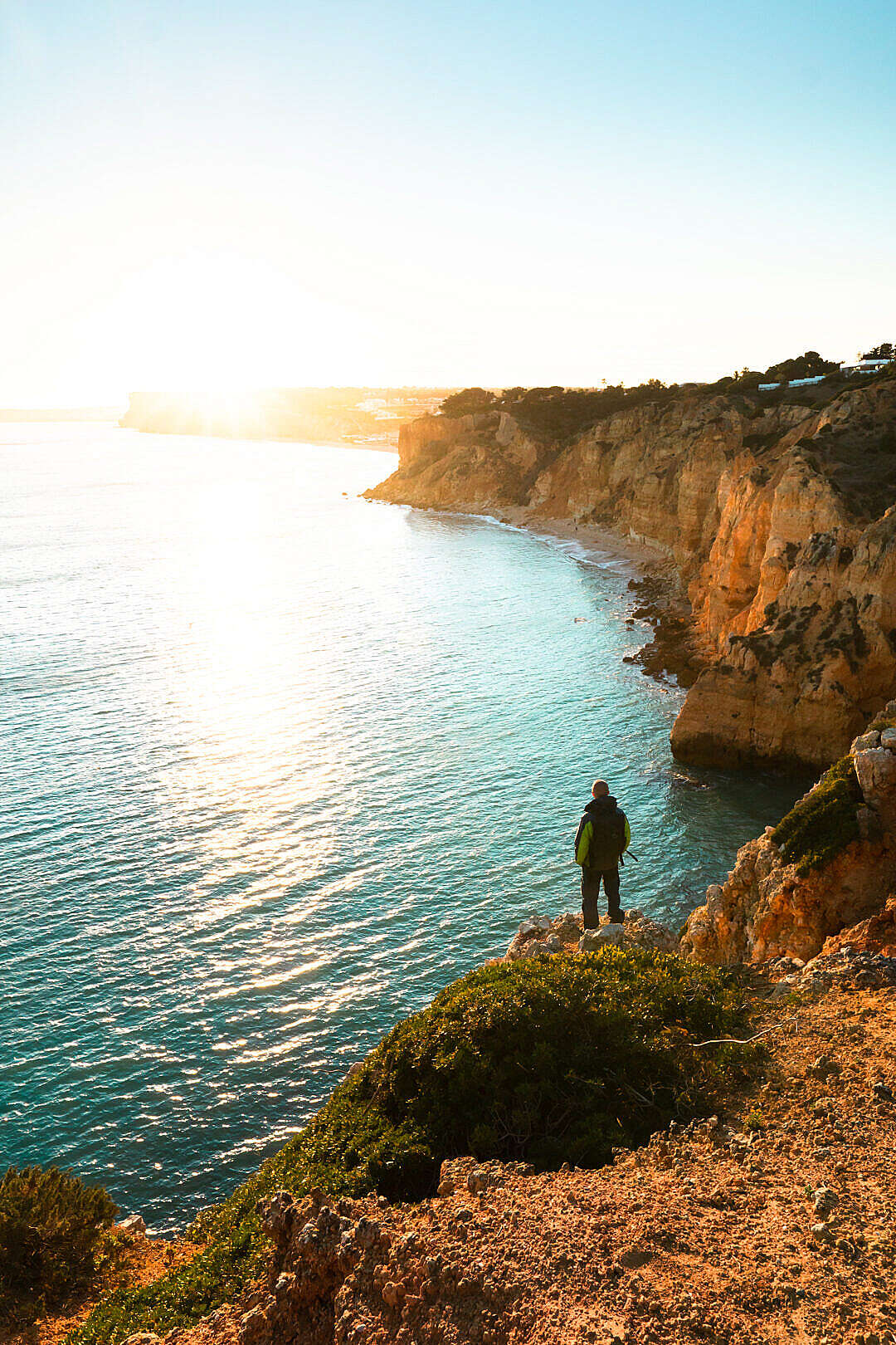 Download Man Watching Sunset in Southern Portugal FREE Stock Photo
