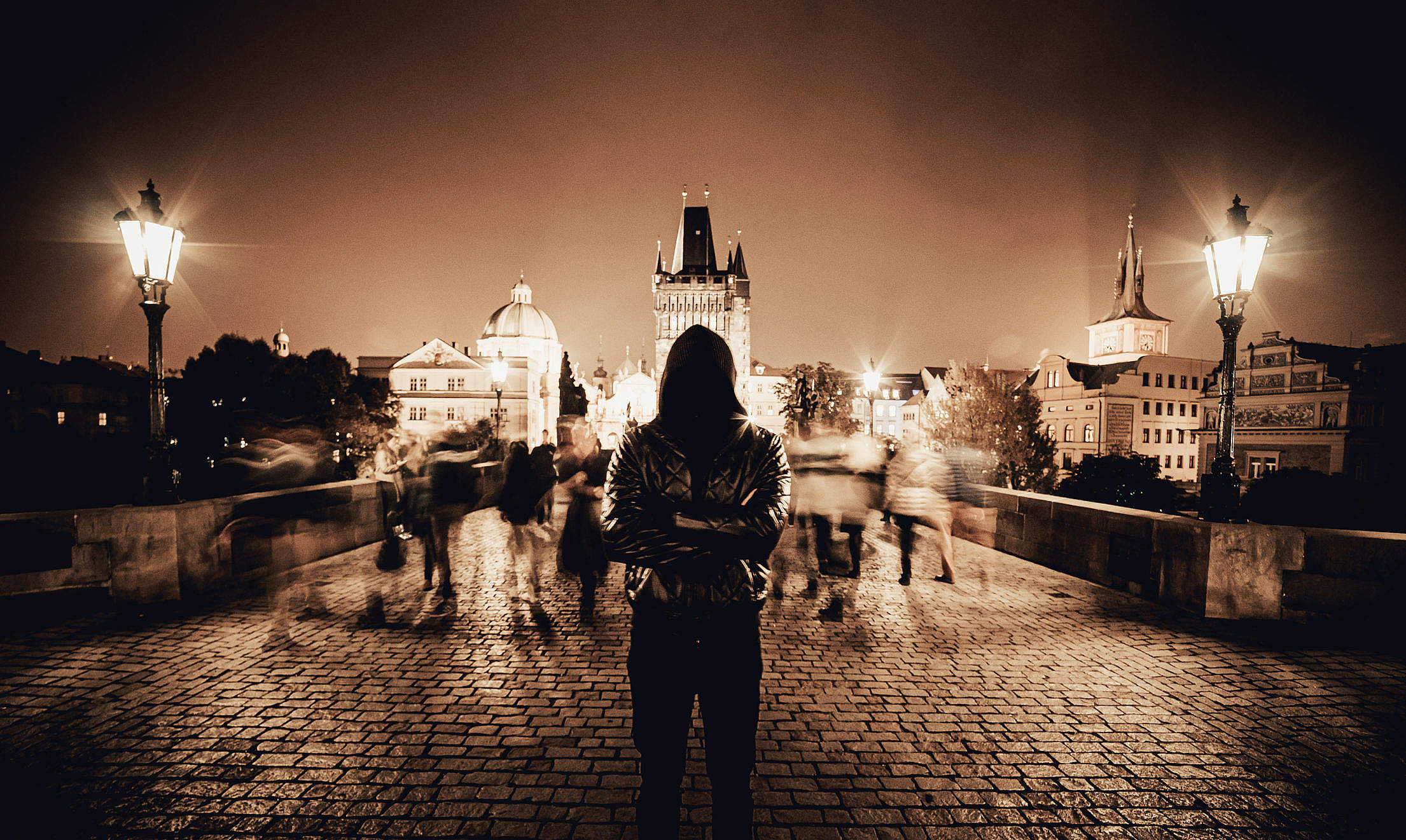 Man with Crossed Arms on Charles Bridge in Prague Free Stock Photo