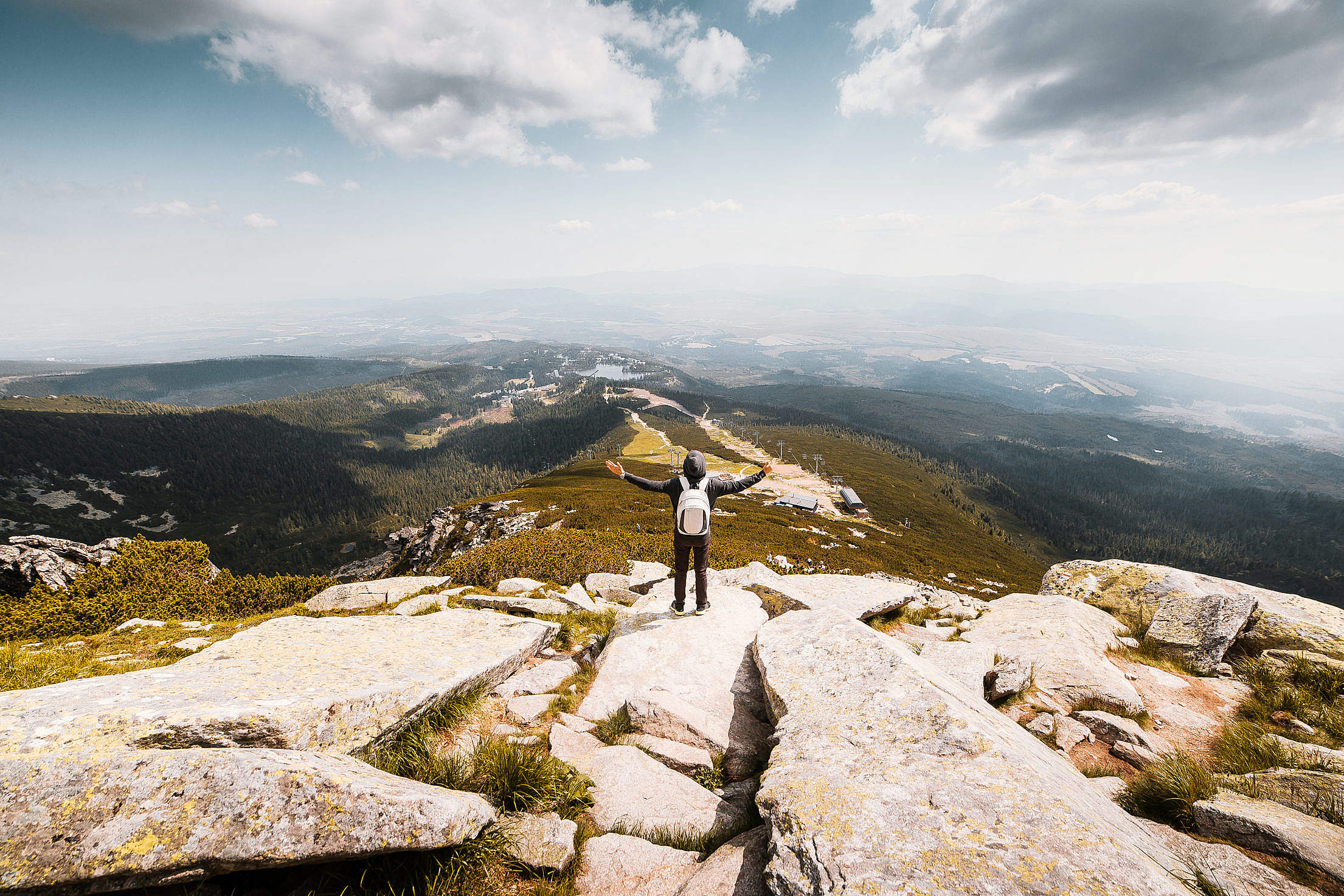 Download Man with Open Arms Saluting the Nature Free Stock Photo