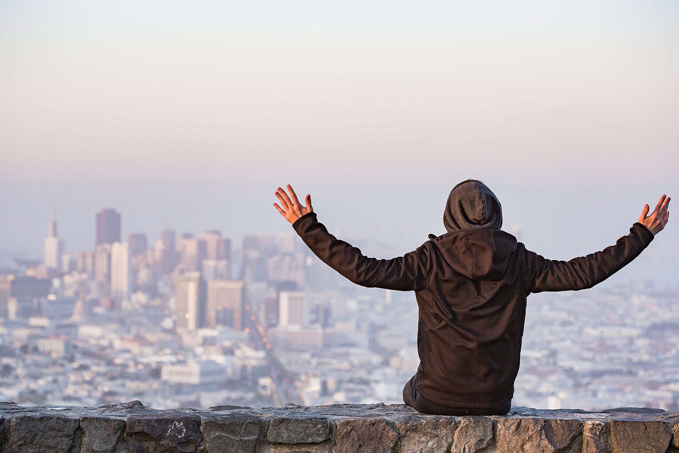 Man with Open Arms Saluting the San Francisco City Free Stock Photo
