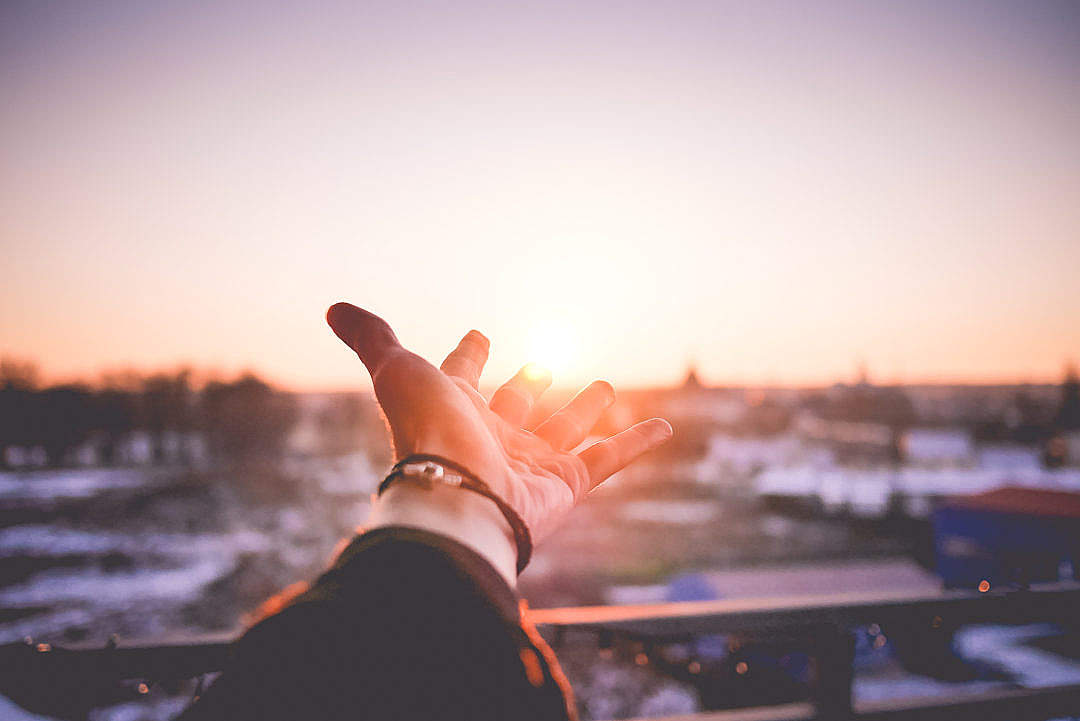 Download Man's Hand is Trying To Reach The Sun FREE Stock Photo