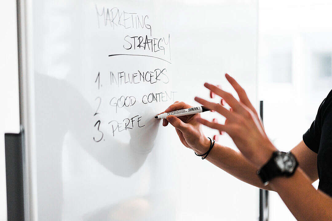 Download Marketing Expert Explaining New Marketing Strategy to Coworkers FREE Stock Photo