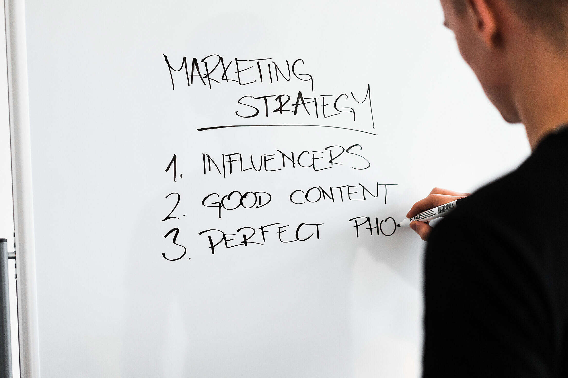 Marketing Expert Writing New Marketing Strategy on Whiteboard Free Stock Photo