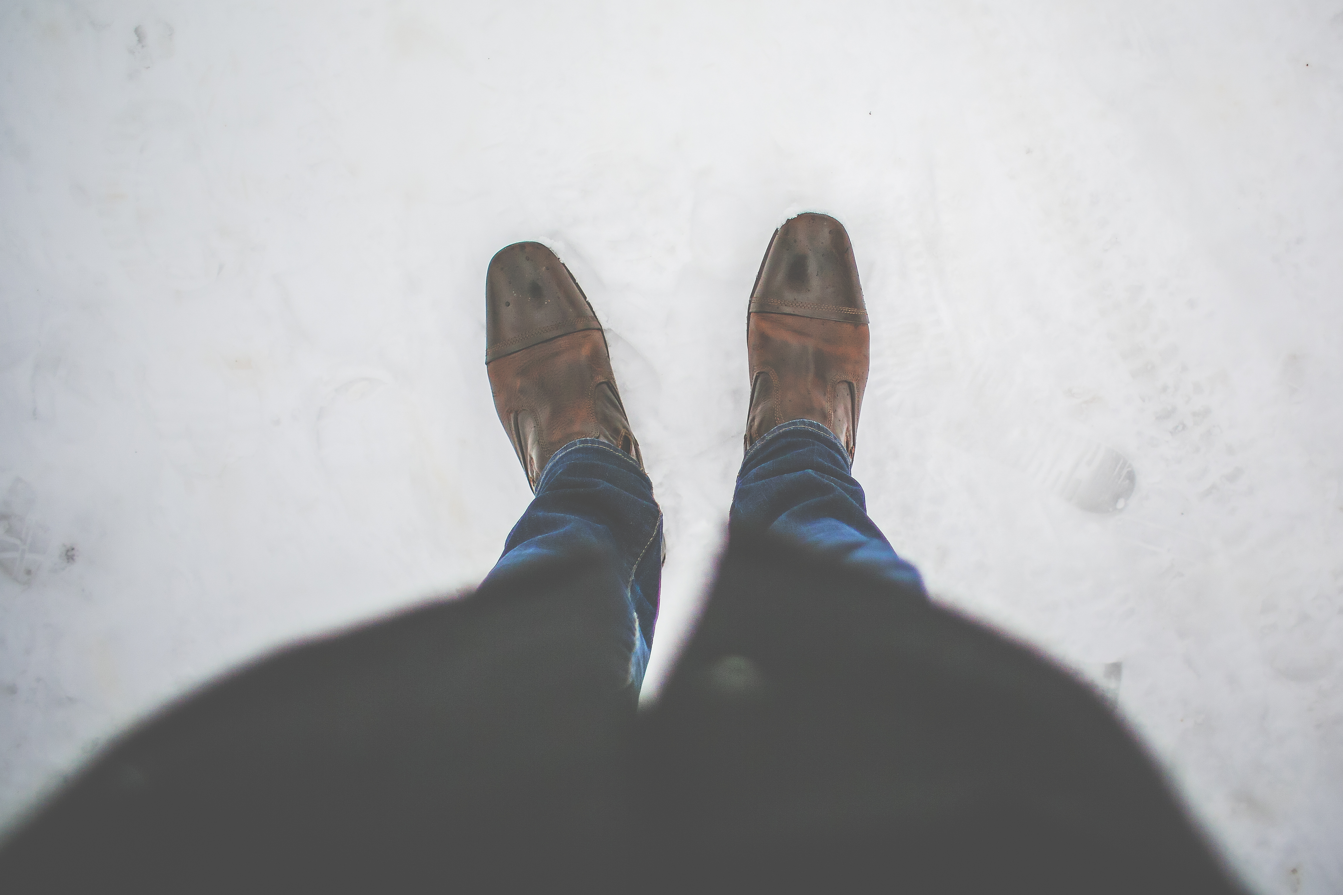 Men Leather Shoes in Snow Free Stock Photo