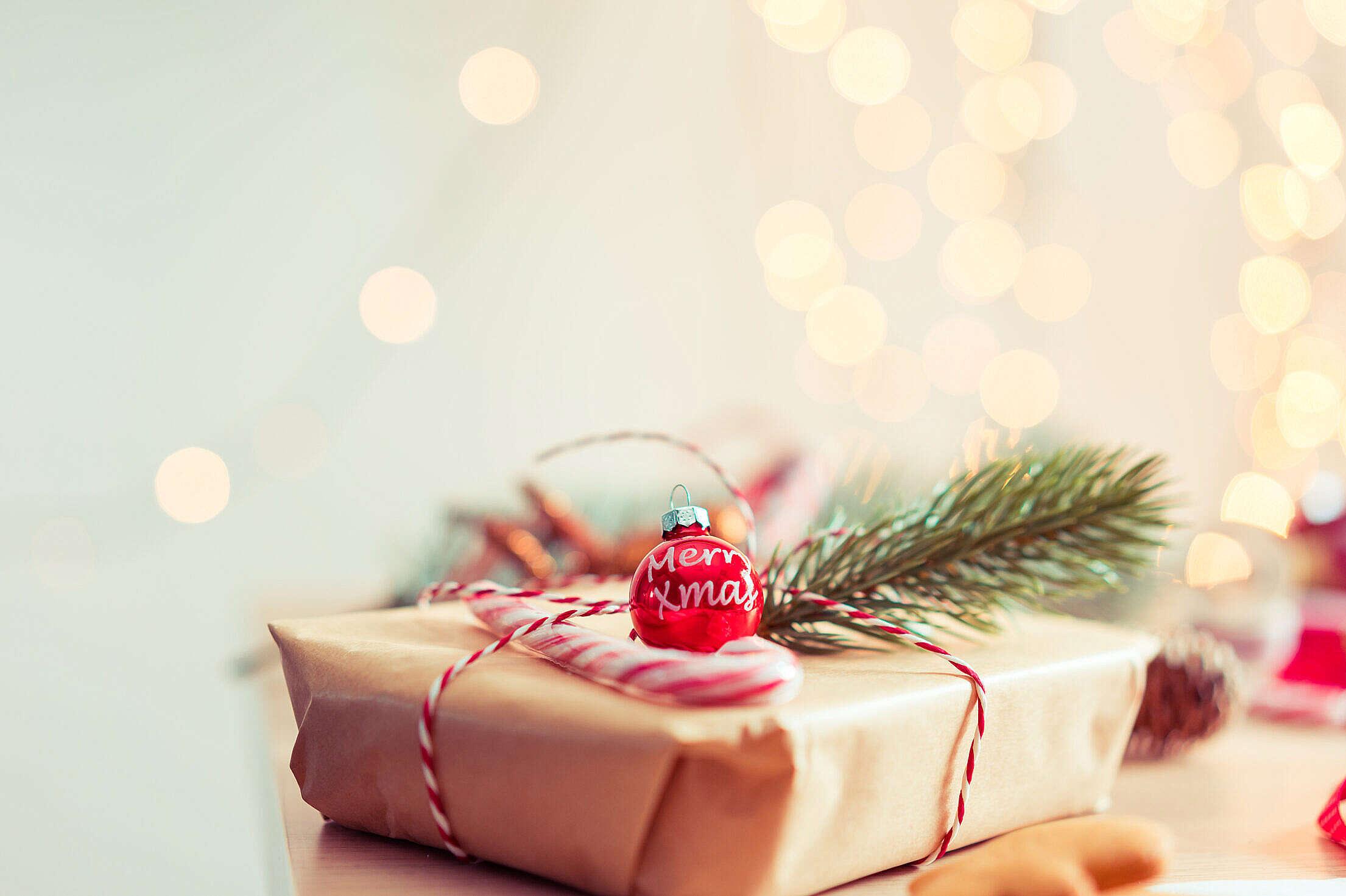 Merry Xmas Tree Decoration on Christmas Present Free Stock Photo