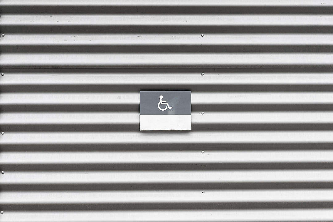 Download Metal Wall with Wheelchair Disabled Sign FREE Stock Photo