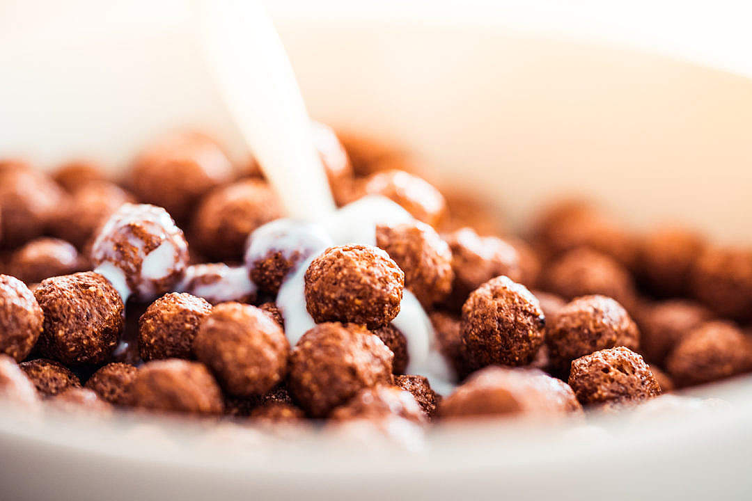Download Milk Pouring on Cereal Chocolate Balls #2 FREE Stock Photo