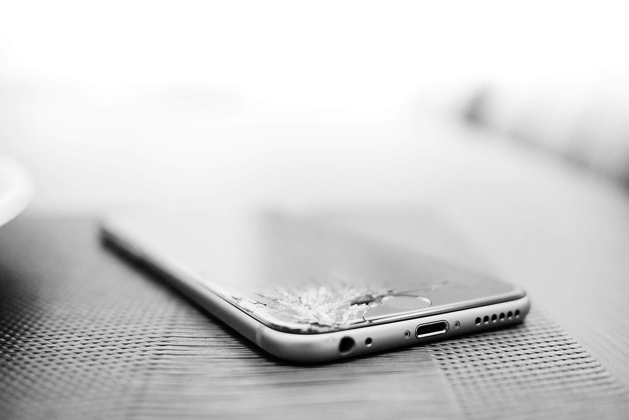 Minimalistic Crashed iPhone with Cracked Screen Free Stock Photo