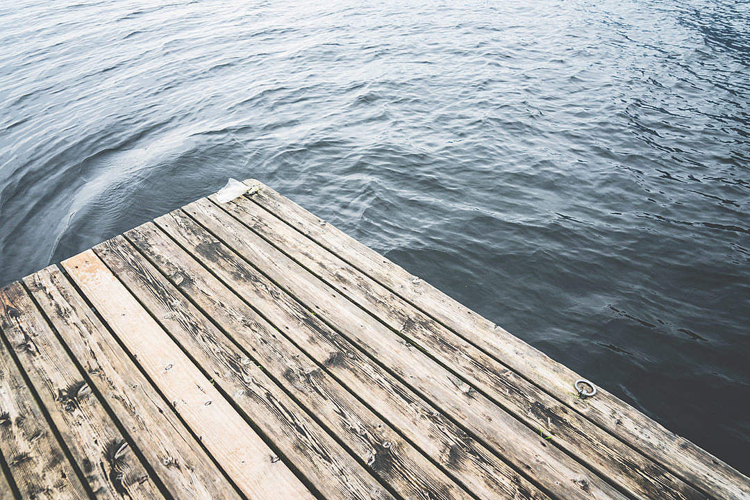 Download Minimalistic Shot of a Wooden Pier on a Lake FREE Stock Photo