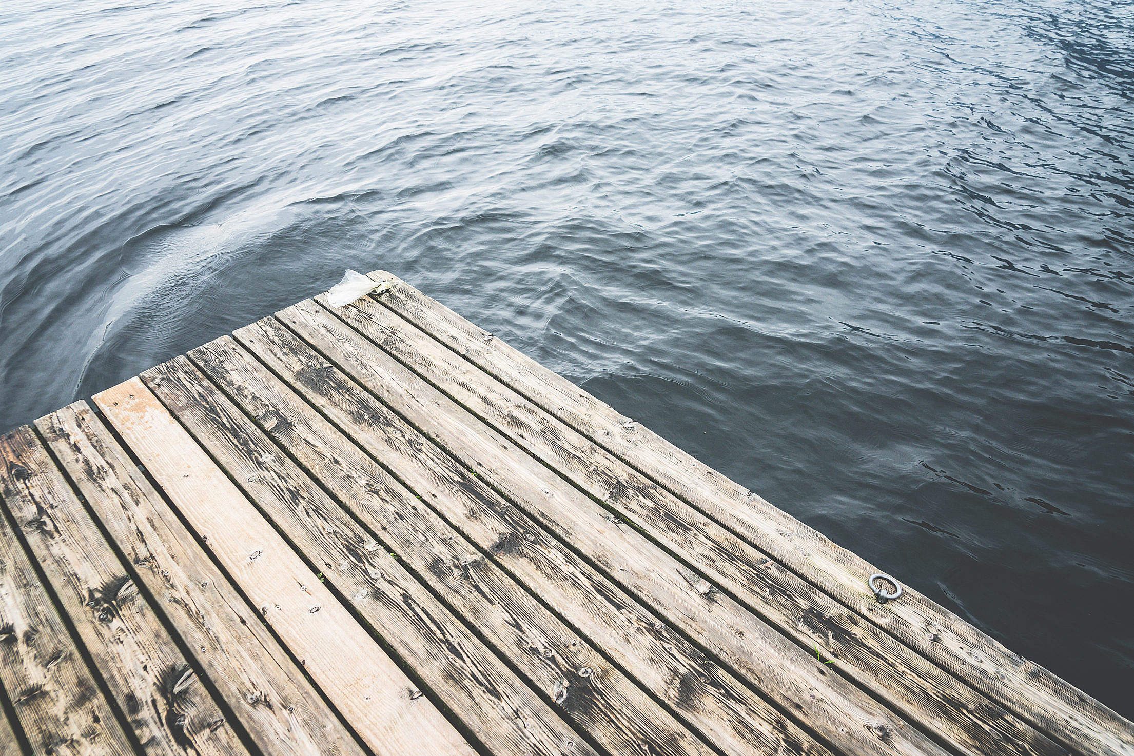 Minimalistic Shot of a Wooden Pier on a Lake Free Stock Photo