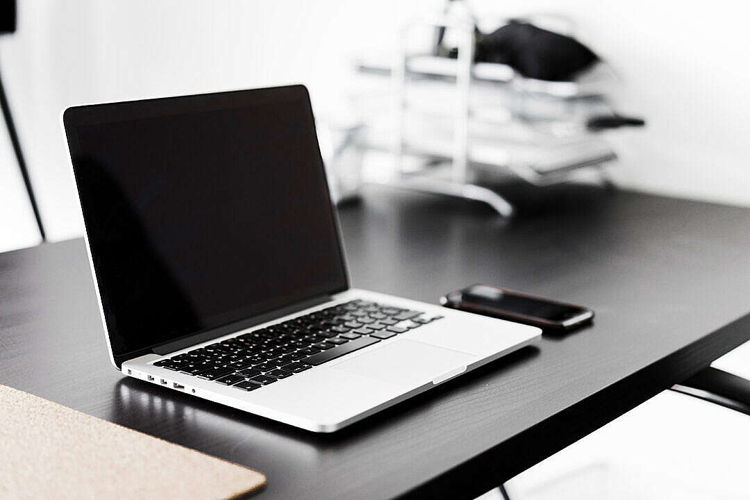 Download Modern Laptop and Smartphone on Black Desk FREE Stock Photo