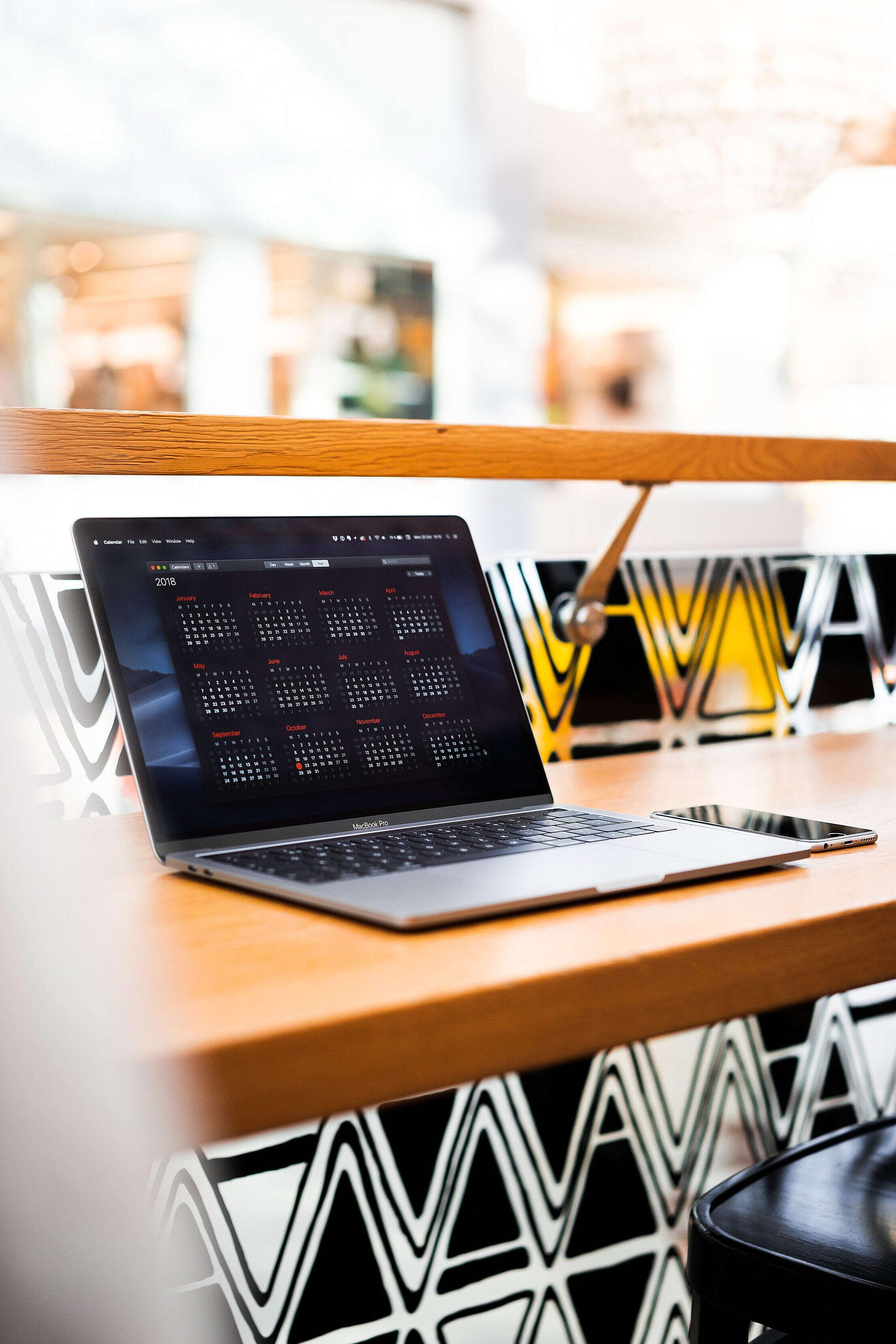 Modern Laptop in Café Vertical Free Stock Photo