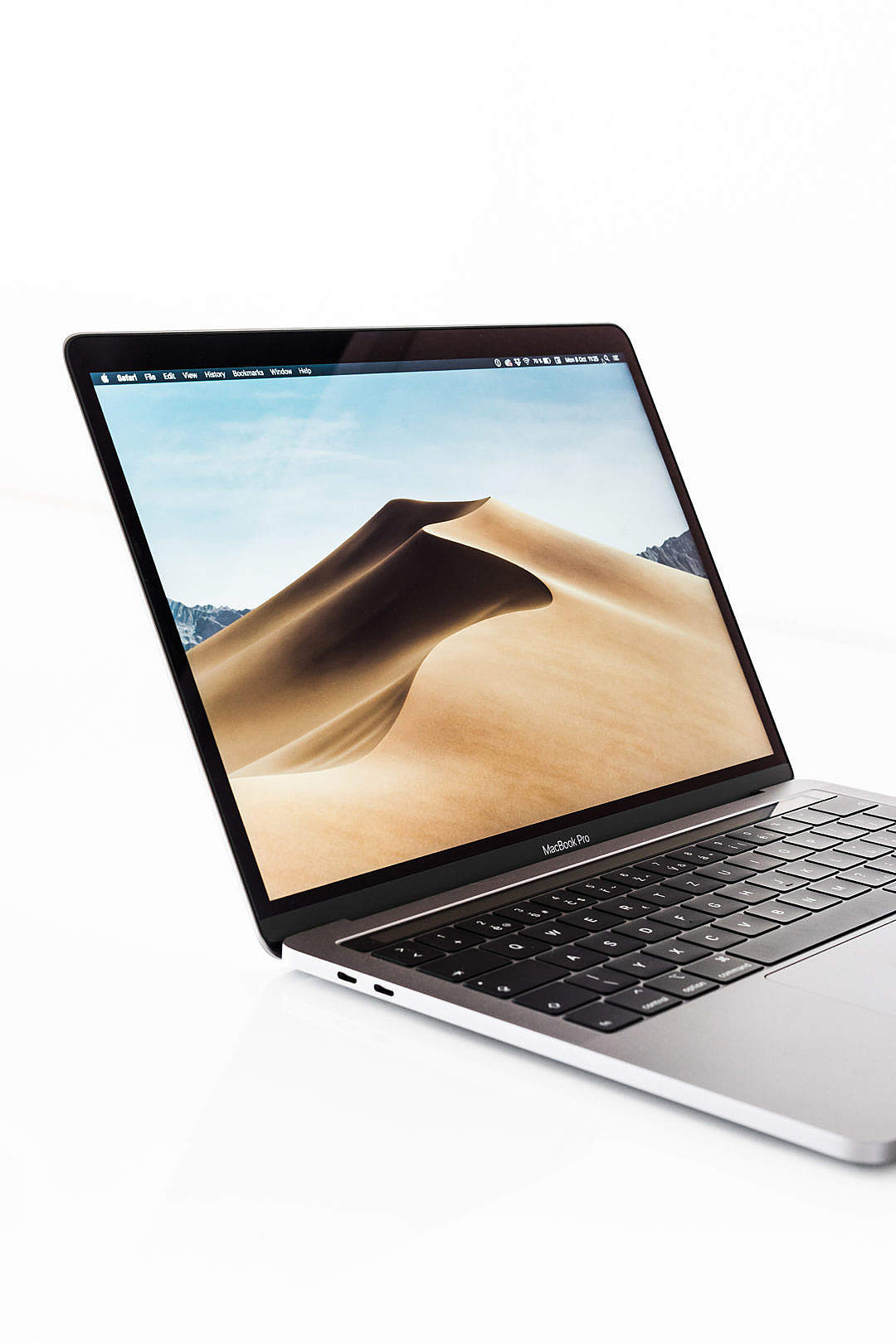 Download Modern Laptop MacBook Pro Mockup Close Up FREE Stock Photo