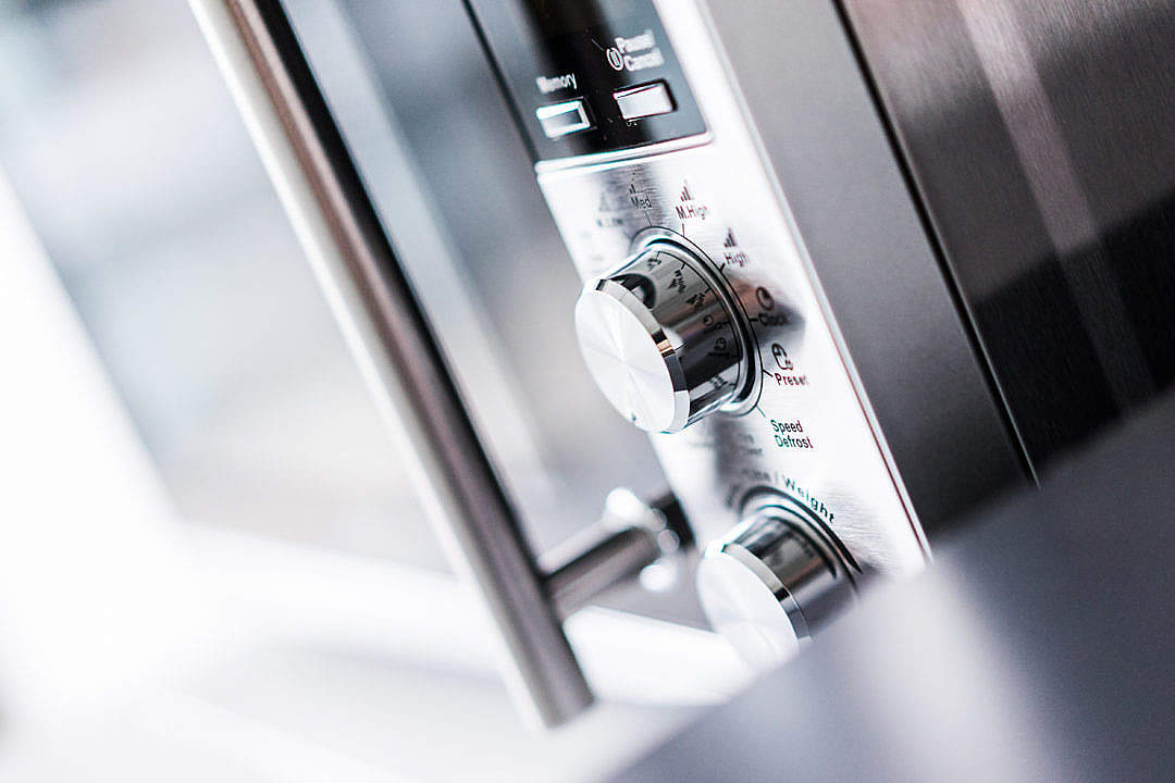 Download Modern Silver Microwave Controls Close Up FREE Stock Photo
