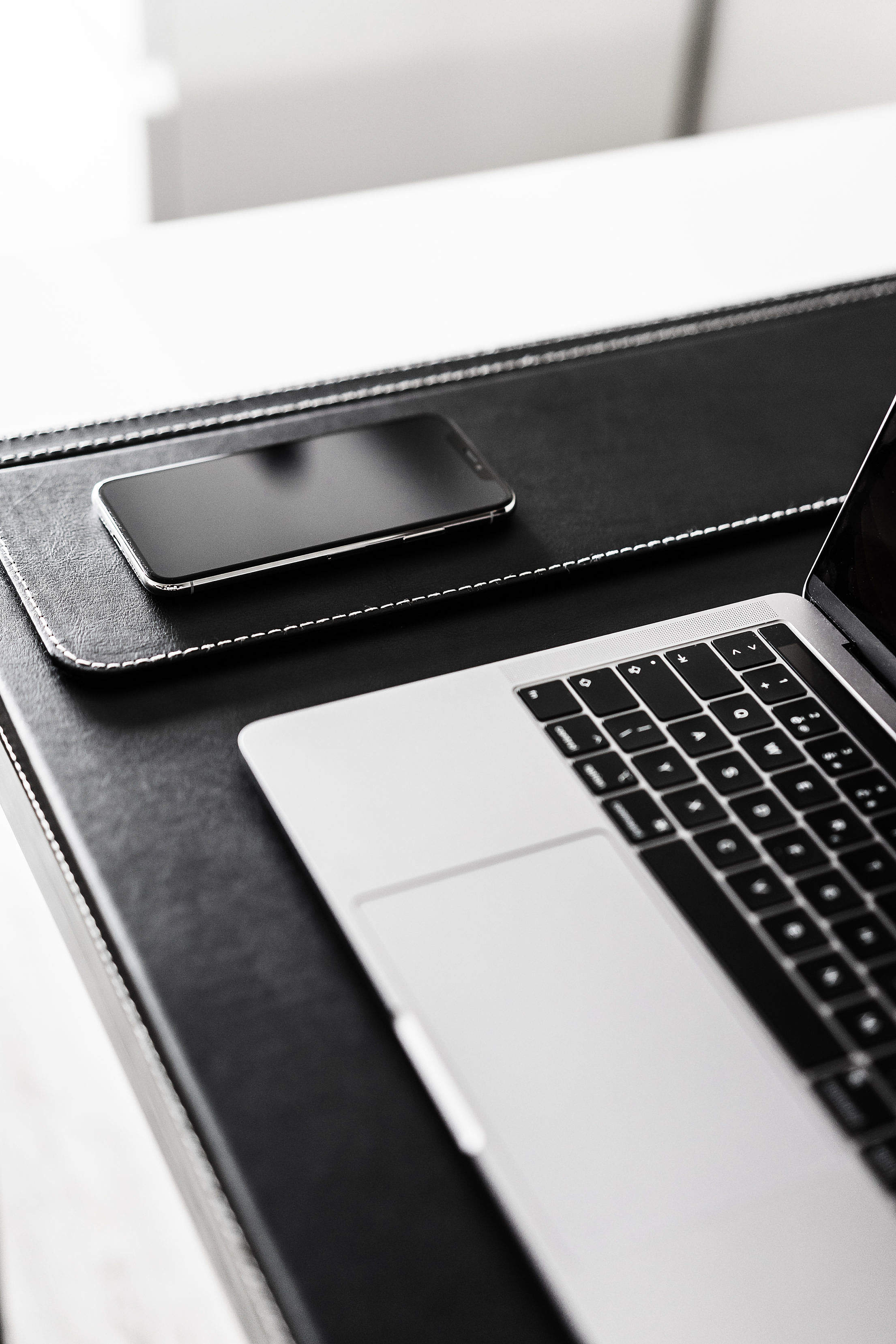 Modern Smartphone and Laptop Vertical Free Stock Photo