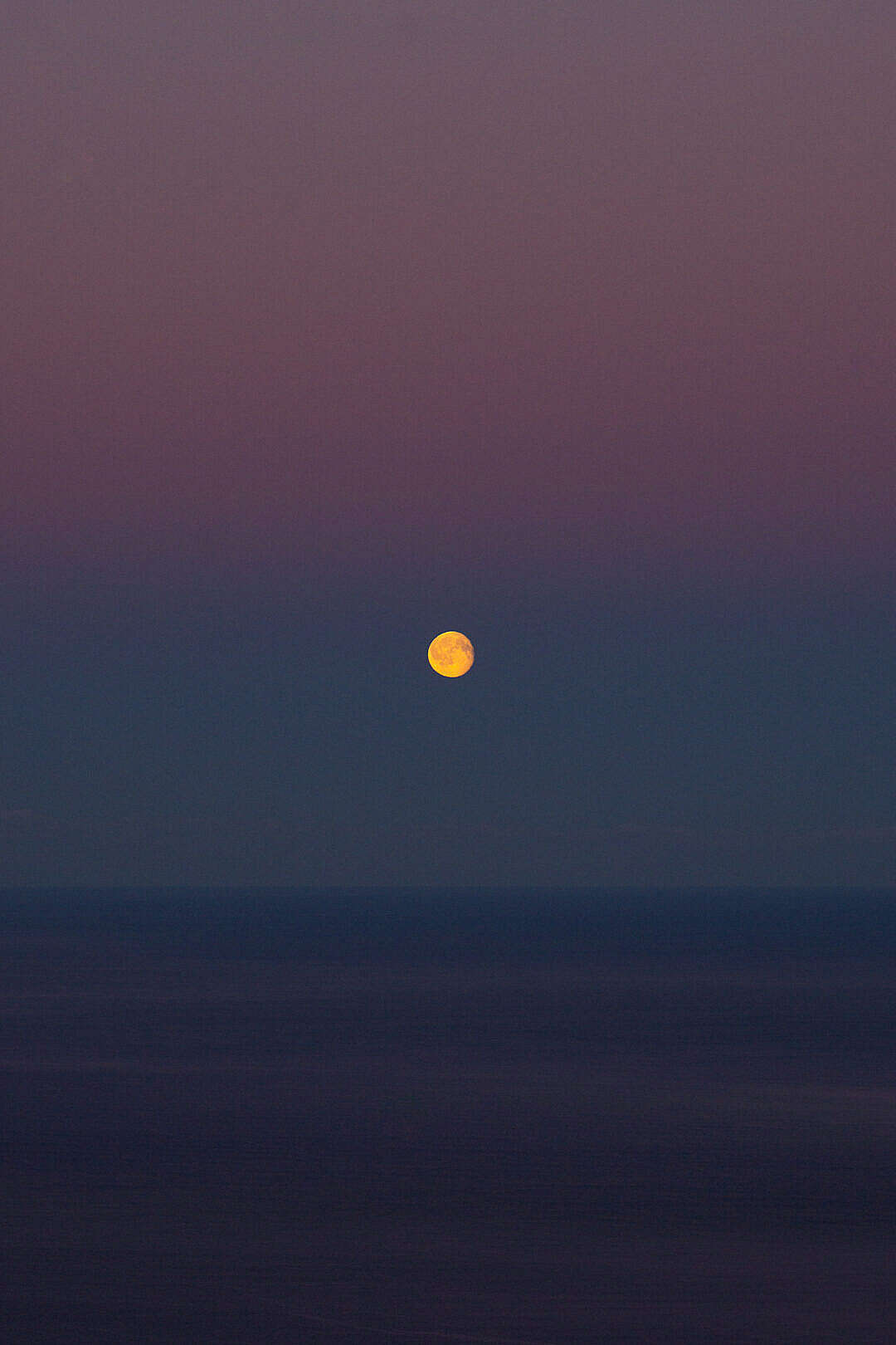 Download Moon over The Sea on a Colorful Dawn Sky FREE Stock Photo
