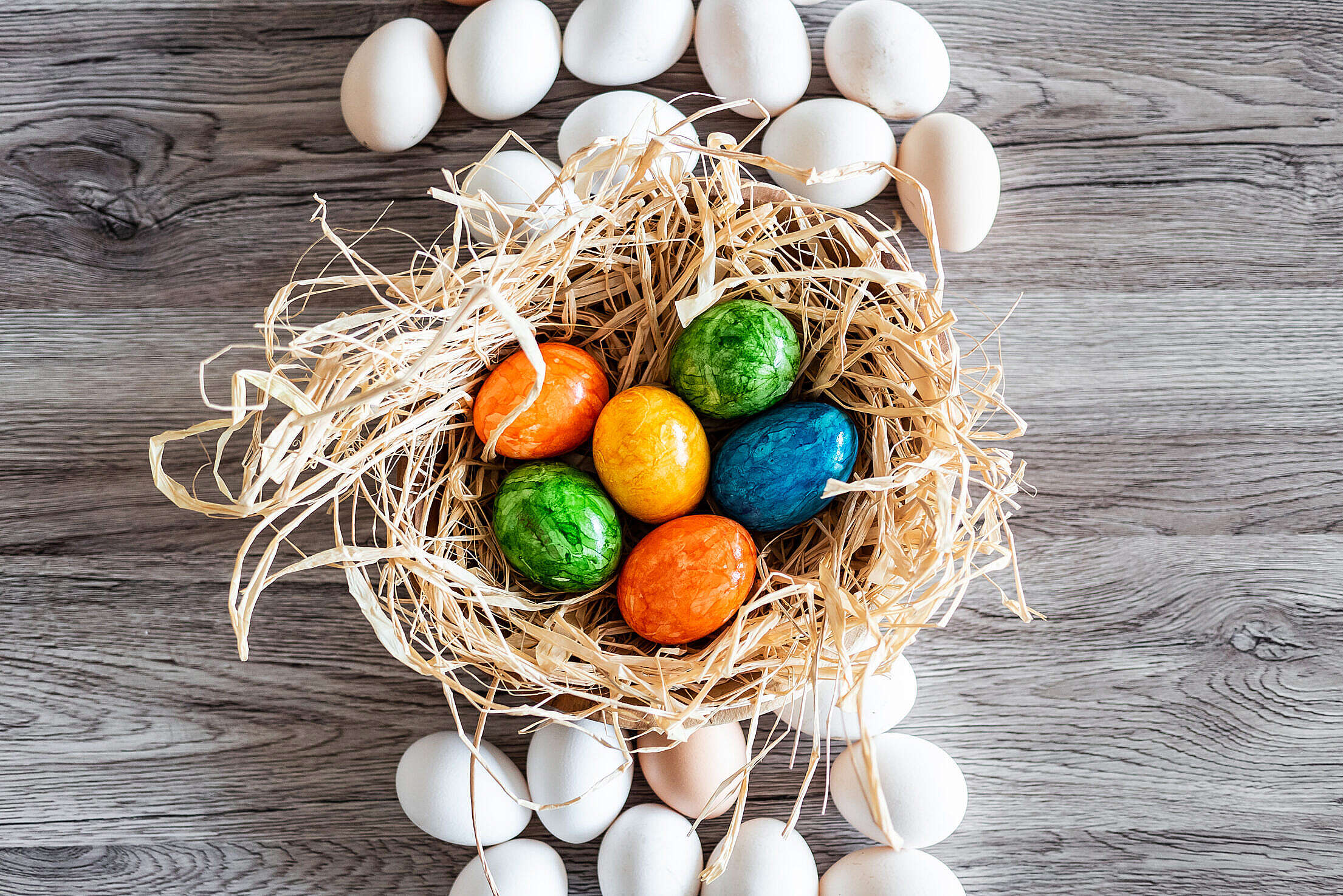 Natural White Eggs and Colored Easter Eggs Free Stock Photo
