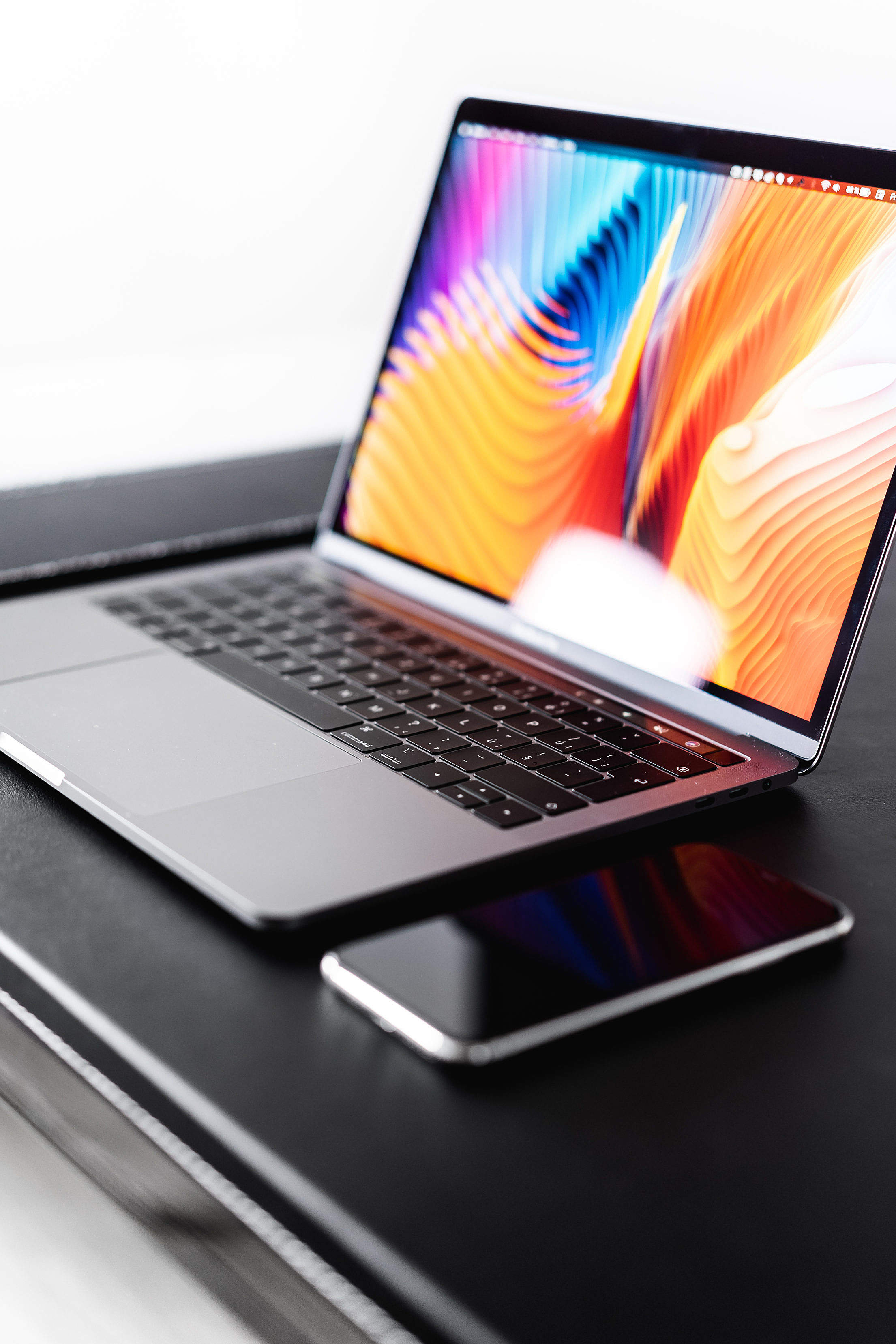 Download New MacBook Pro with iPhone Free Stock Photo