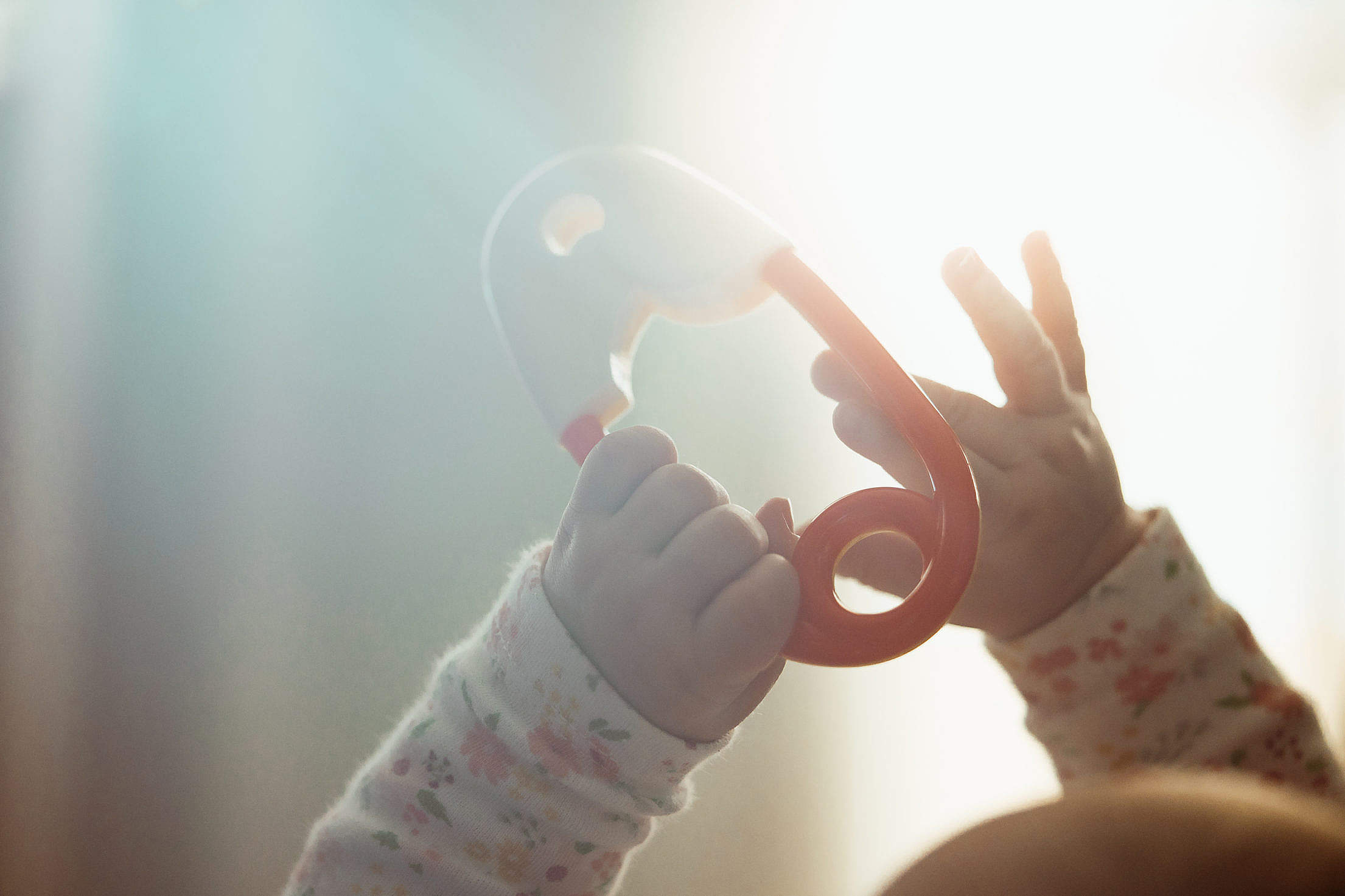 Newborn Baby Hands with a Toy Free Stock Photo