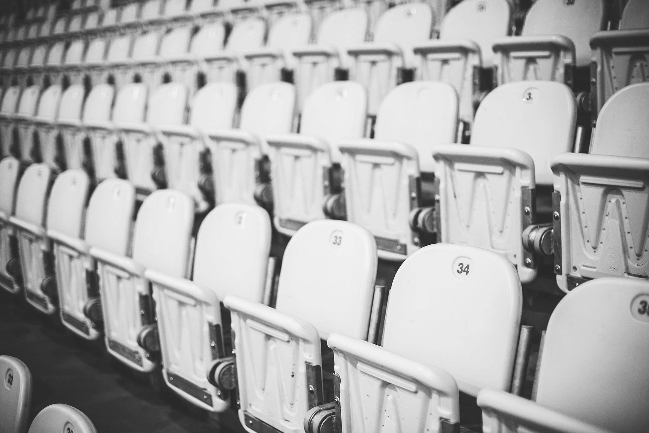 Numbered Stadium Seats in Black and White Free Stock Photo