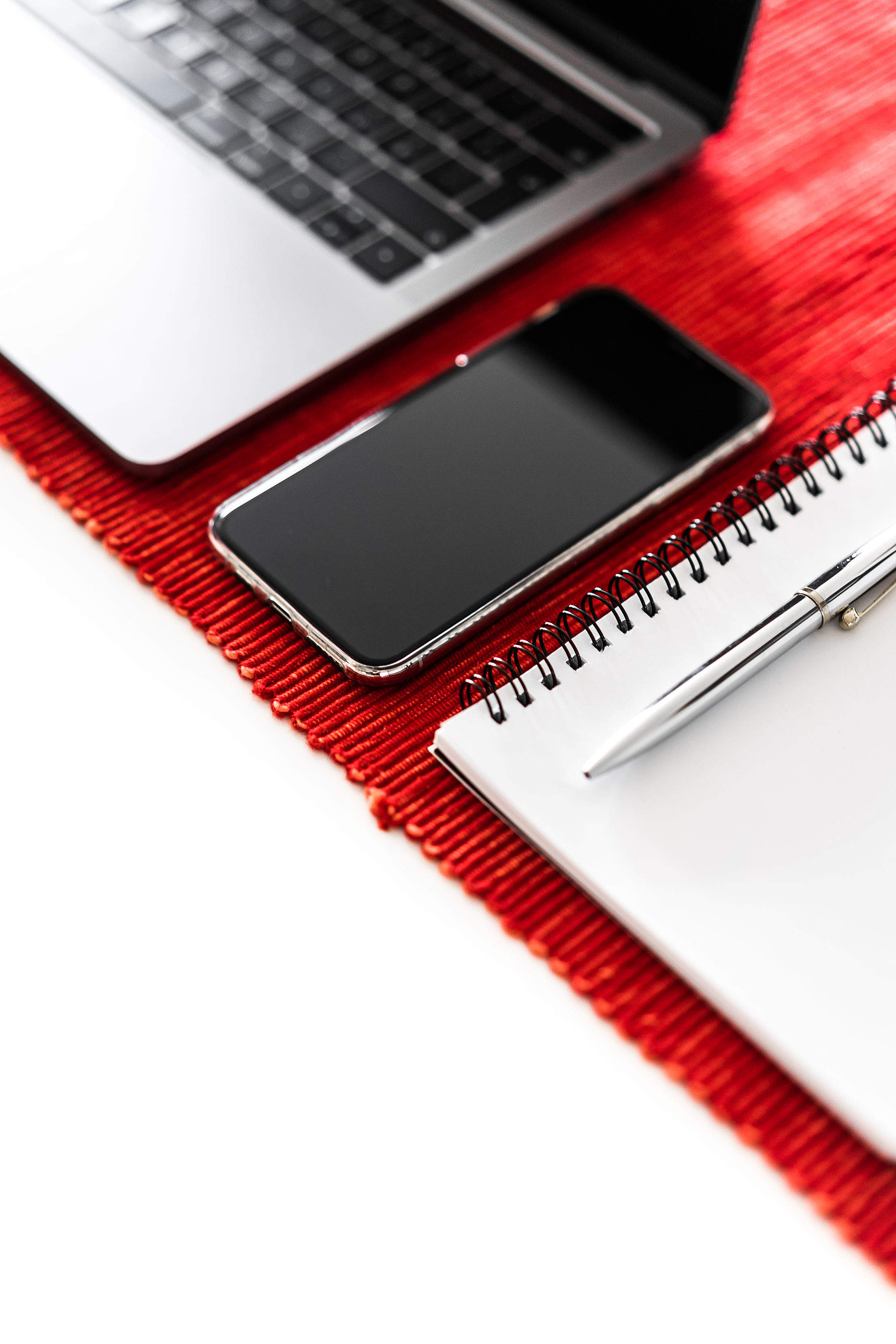Office Essentials: Smartphone, Laptop and Diary Free Stock Photo
