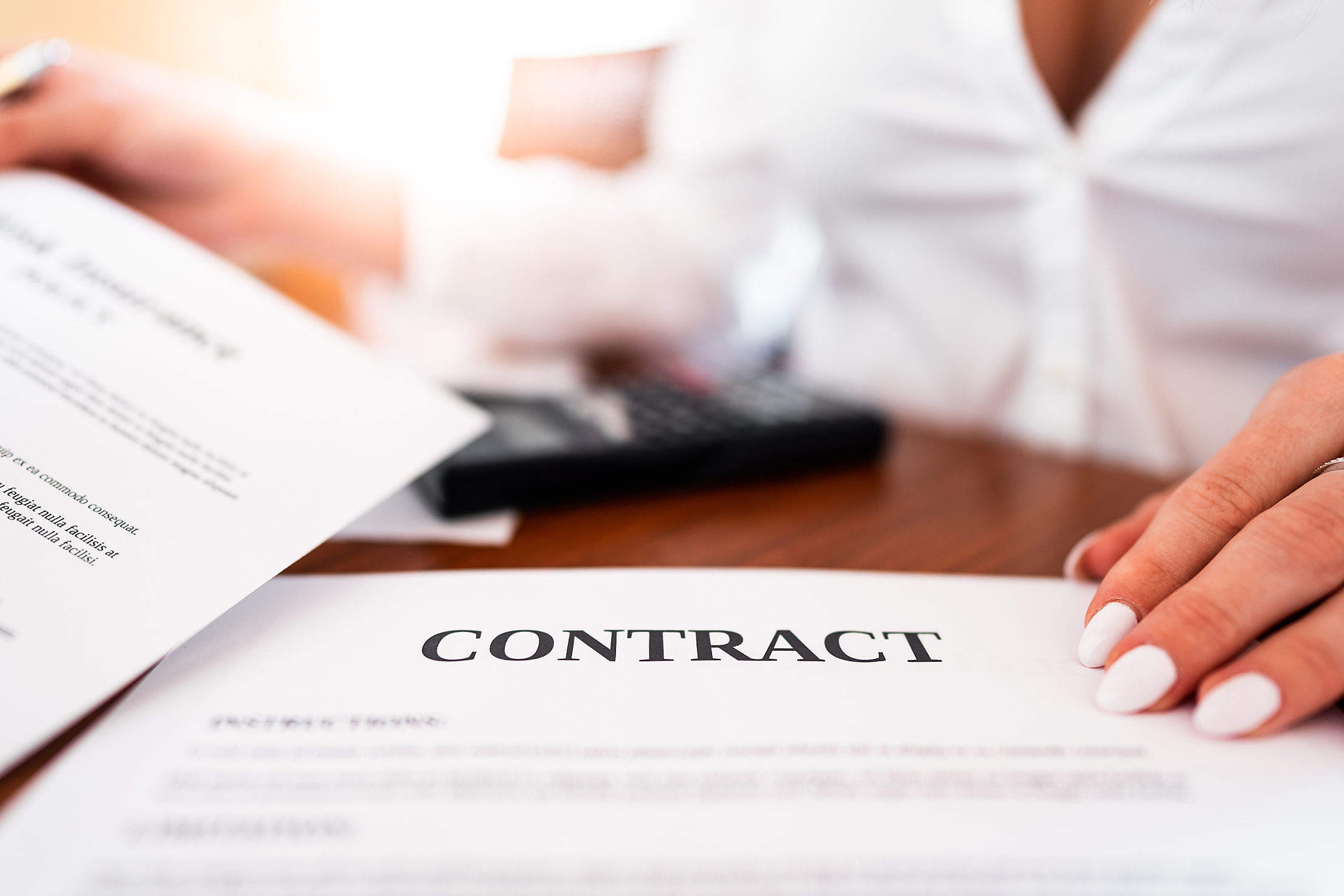 Office Worker Showing a Contract Free Stock Photo
