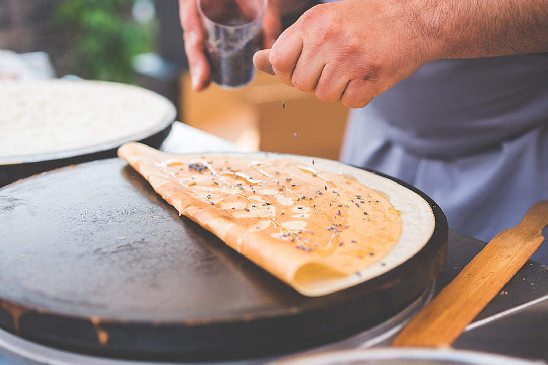 Download Old Man Making Healthy Crepes in Open Air Market FREE Stock Photo