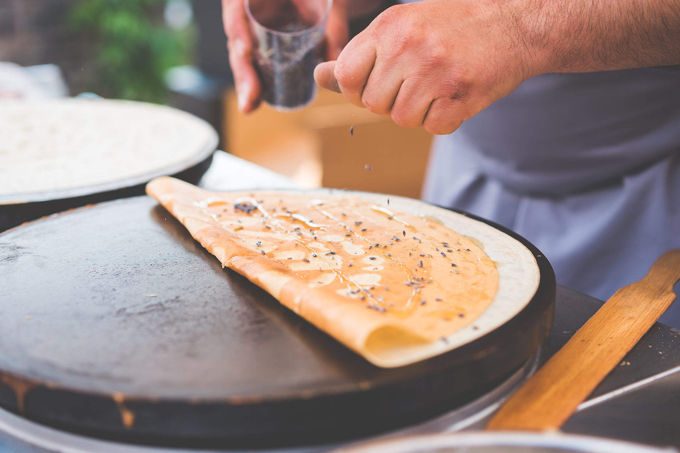 Old Man Making Healthy Crepes in Open Air Market Free Stock Photo