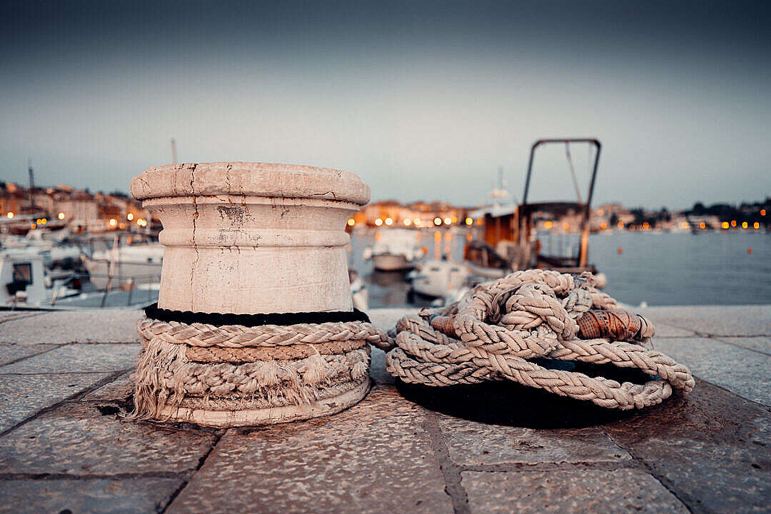 Download Old Marina Bollard with Ropes in Early Evening FREE Stock Photo