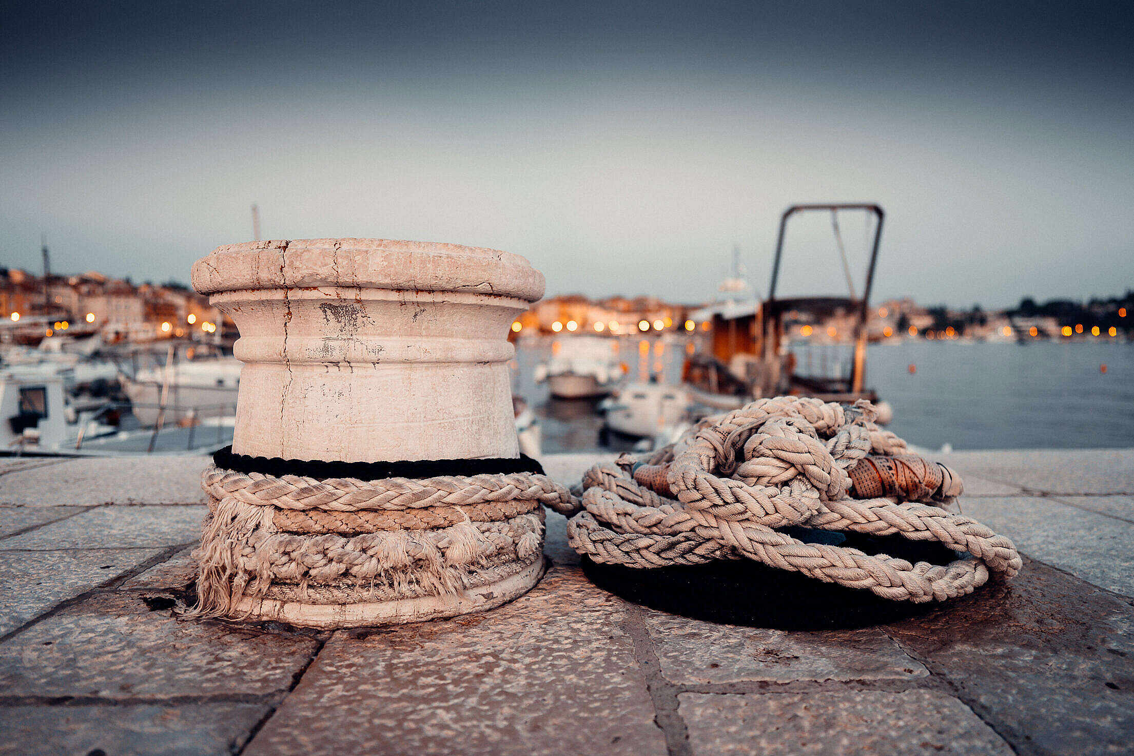 Old Marina Bollard with Ropes in Early Evening Free Stock Photo