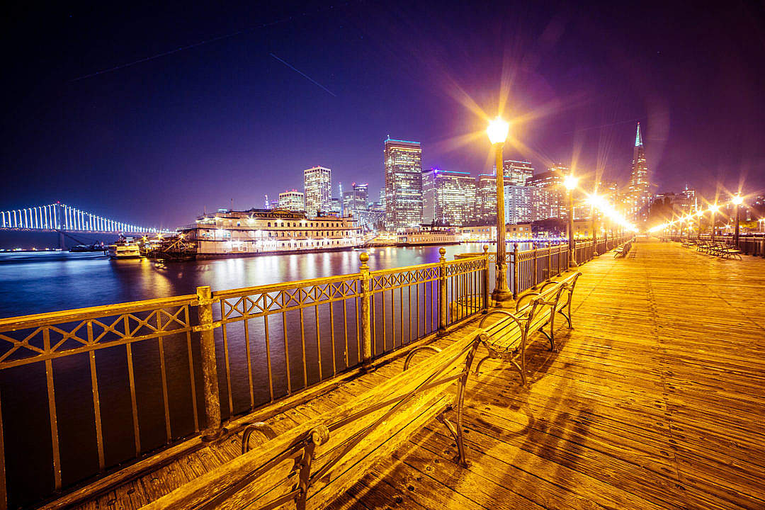 Download Old Pier and San Francisco Skyline with Bay Bridge at Night FREE Stock Photo
