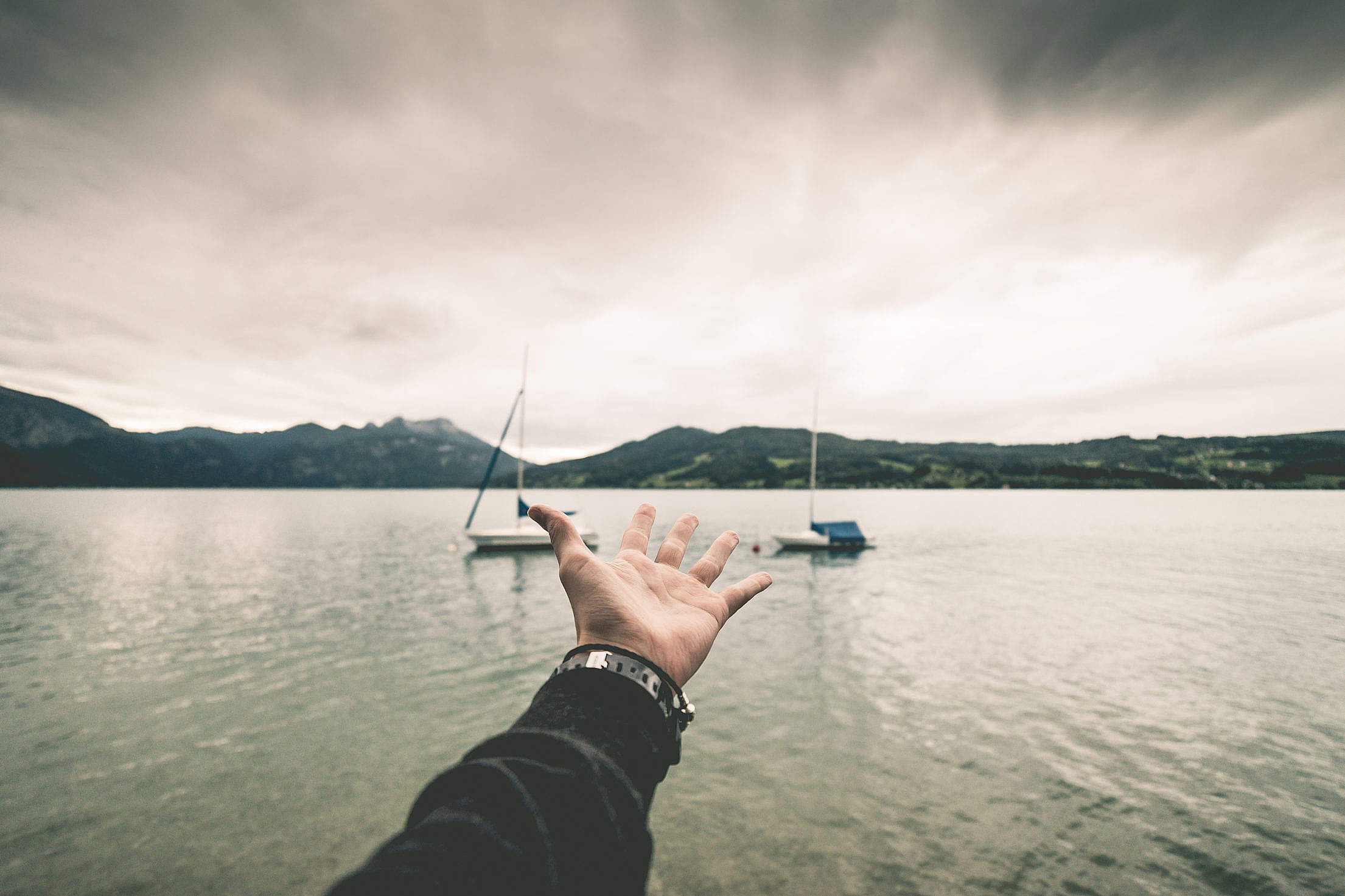 Open Hand Reaching The Other Faraway Side Free Stock Photo