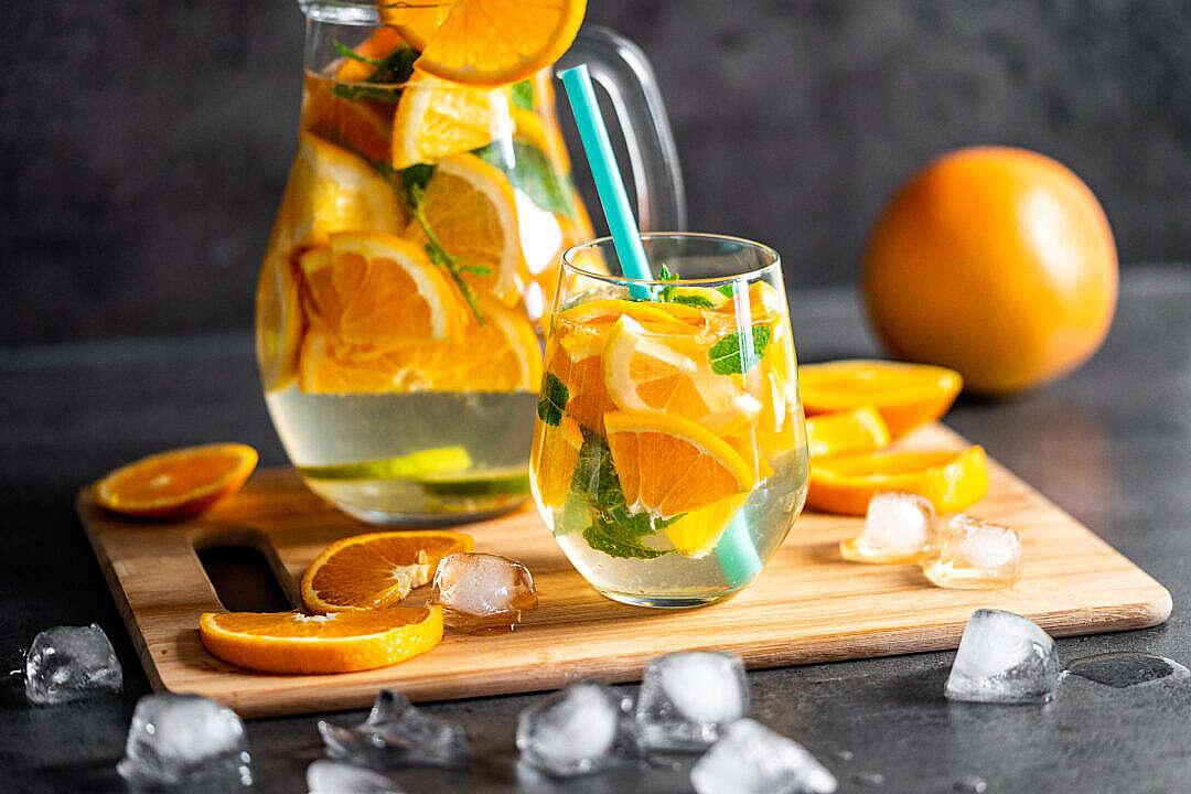 Download Orange Lemonade with Ice Cubes FREE Stock Photo